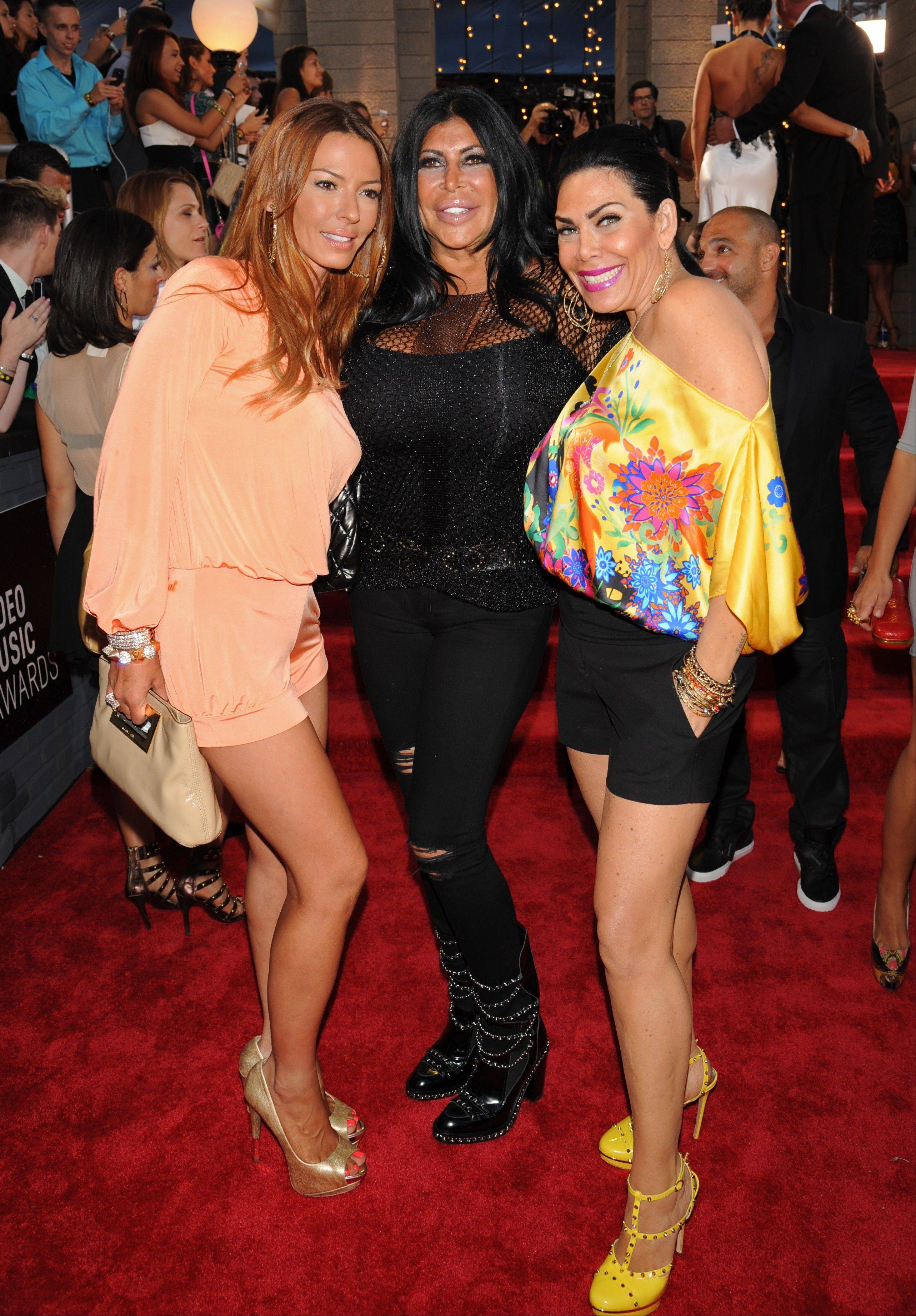 "Cast members, from left, Drita D'Avanzo, Angela Raiola and Renee Graziano from ""Mob Wives"" arrive at the MTV Video Music Awards on Sunday, Aug. 25, 2013, at the Barclays Center in the Brooklyn borough of New York."