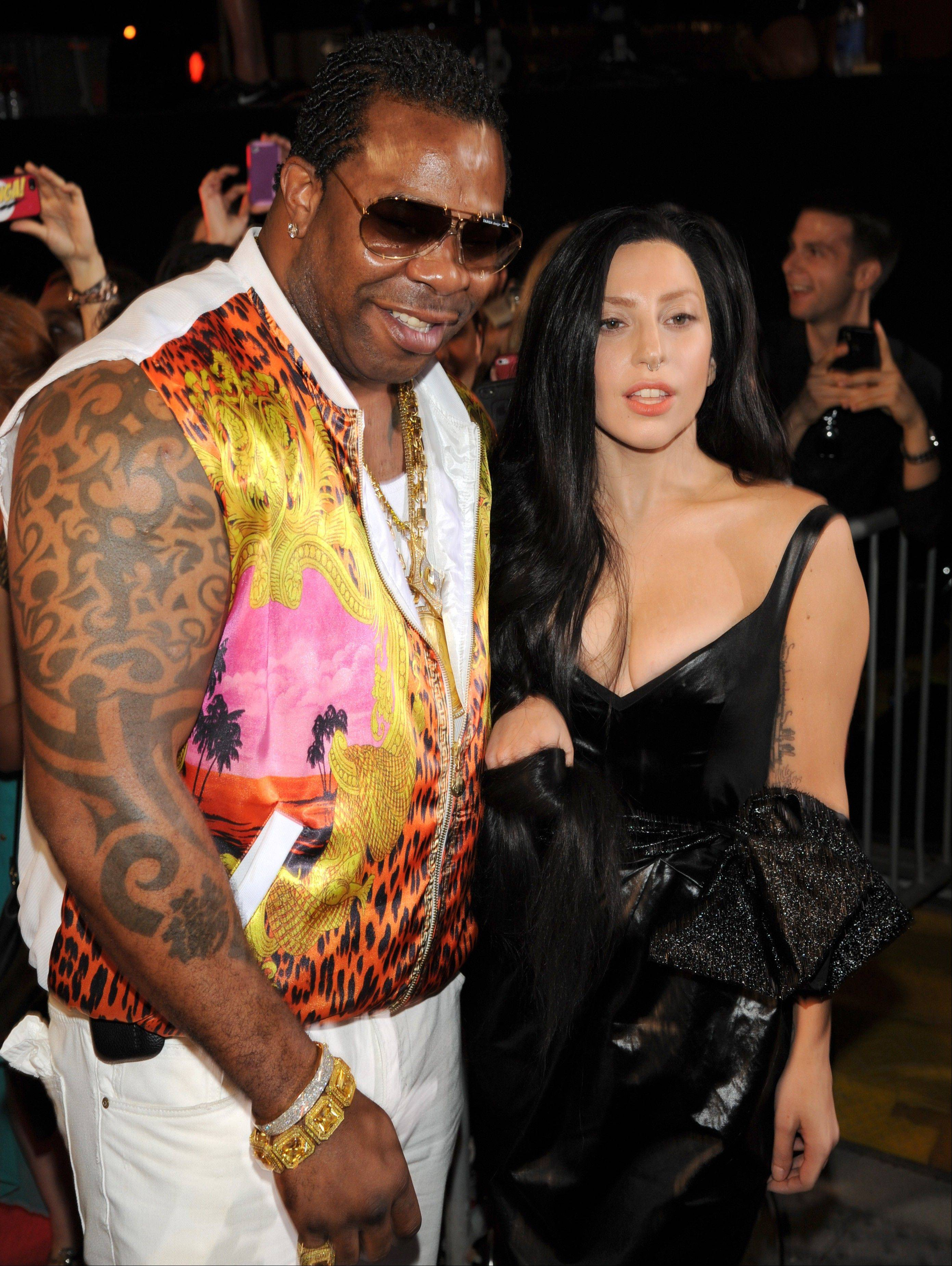 Busta Rhymes, from left, and Lady Gaga arrive at the MTV Video Music Awards on Sunday, Aug. 25, 2013, at the Barclays Center in the Brooklyn borough of New York.