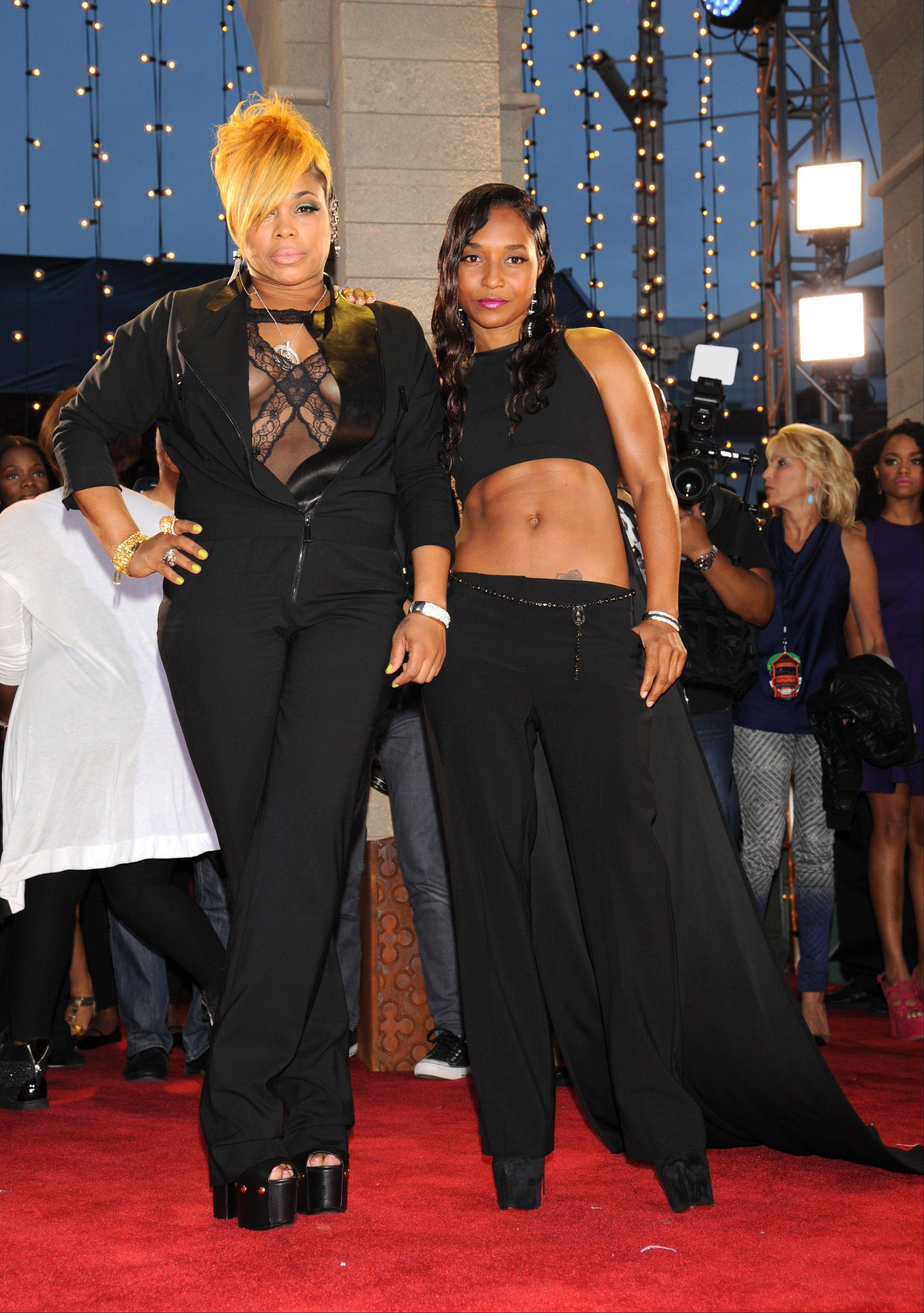 Tionne 'T-Boz' Watkins and Rozonda 'Chilli' Thomas, right, of TLC arrive at the MTV Video Music Awards on Sunday, Aug. 25, 2013, at the Barclays Center in the Brooklyn borough of New York.