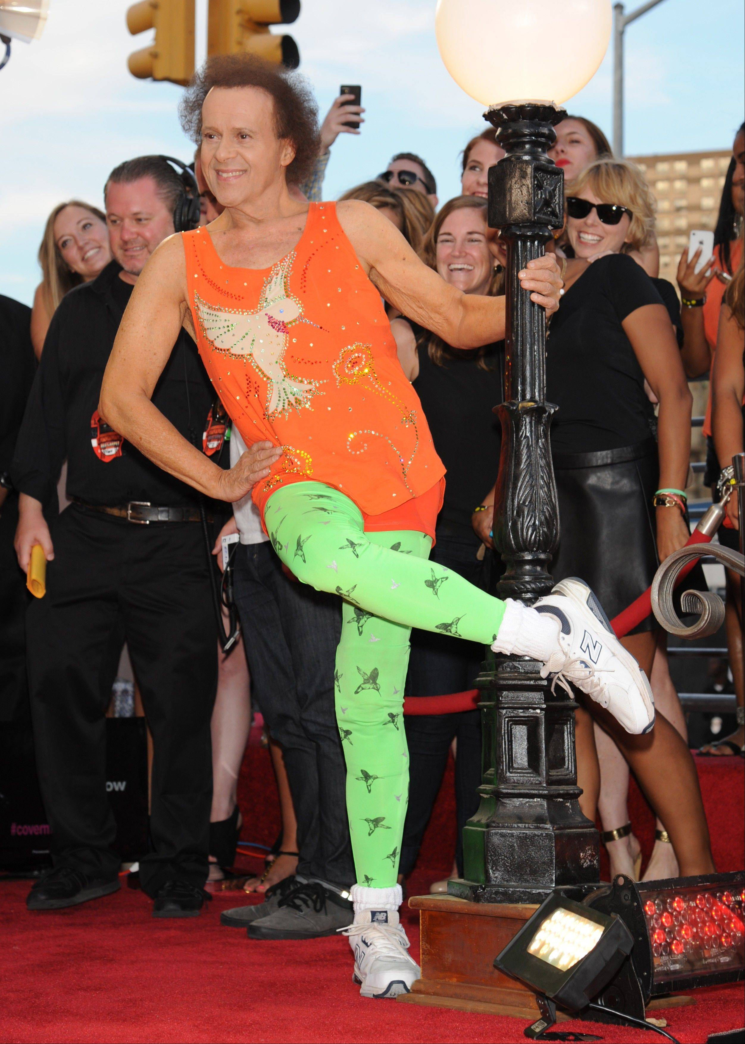 Fitness guru Richard Simmons arrives at the MTV Video Music Awards on Sunday, Aug. 25, 2013, at the Barclays Center in the Brooklyn borough of New York.