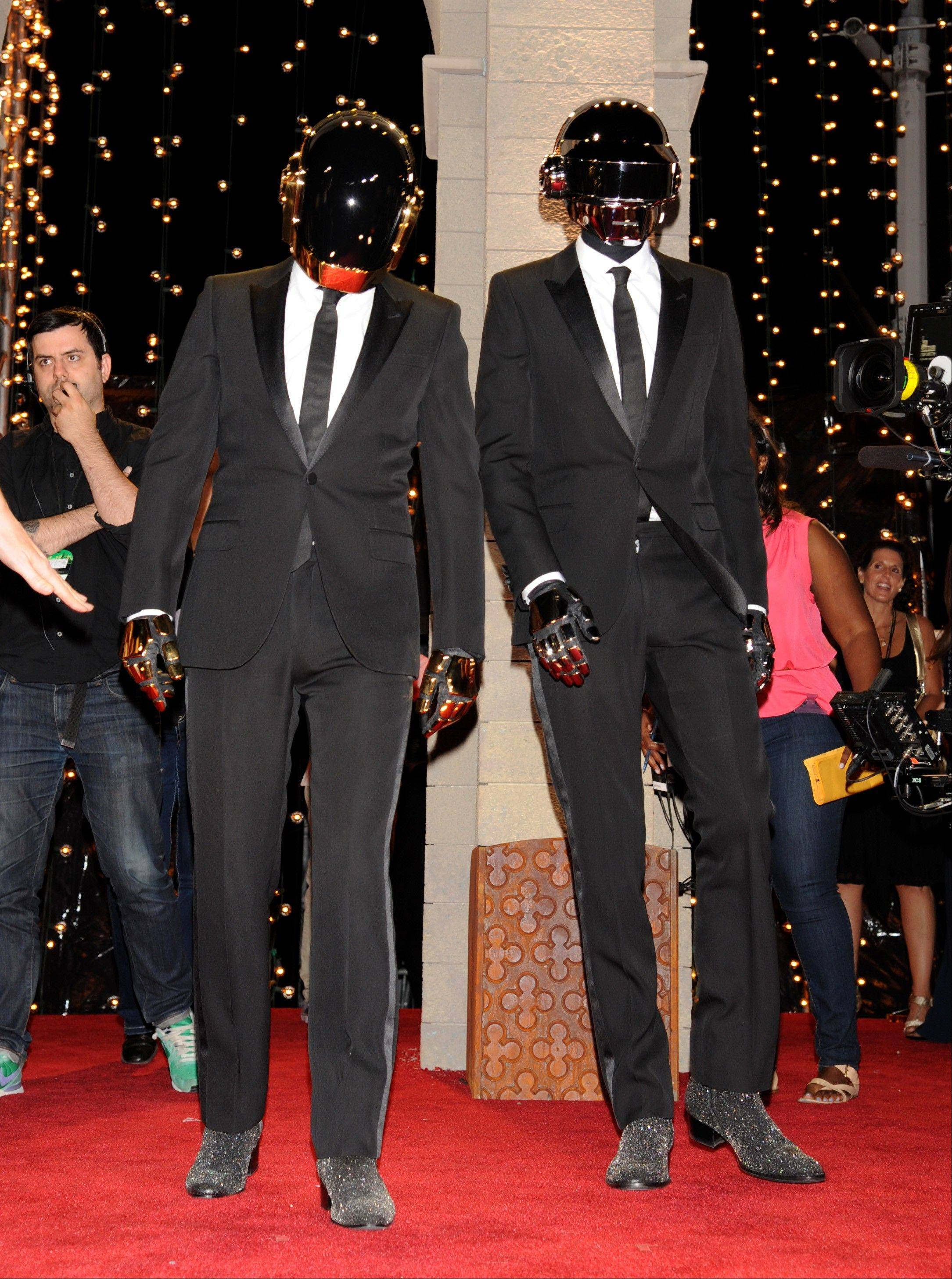Daft Punk arrives at the MTV Video Music Awards on Sunday, Aug. 25, 2013, at the Barclays Center in the Brooklyn borough of New York.