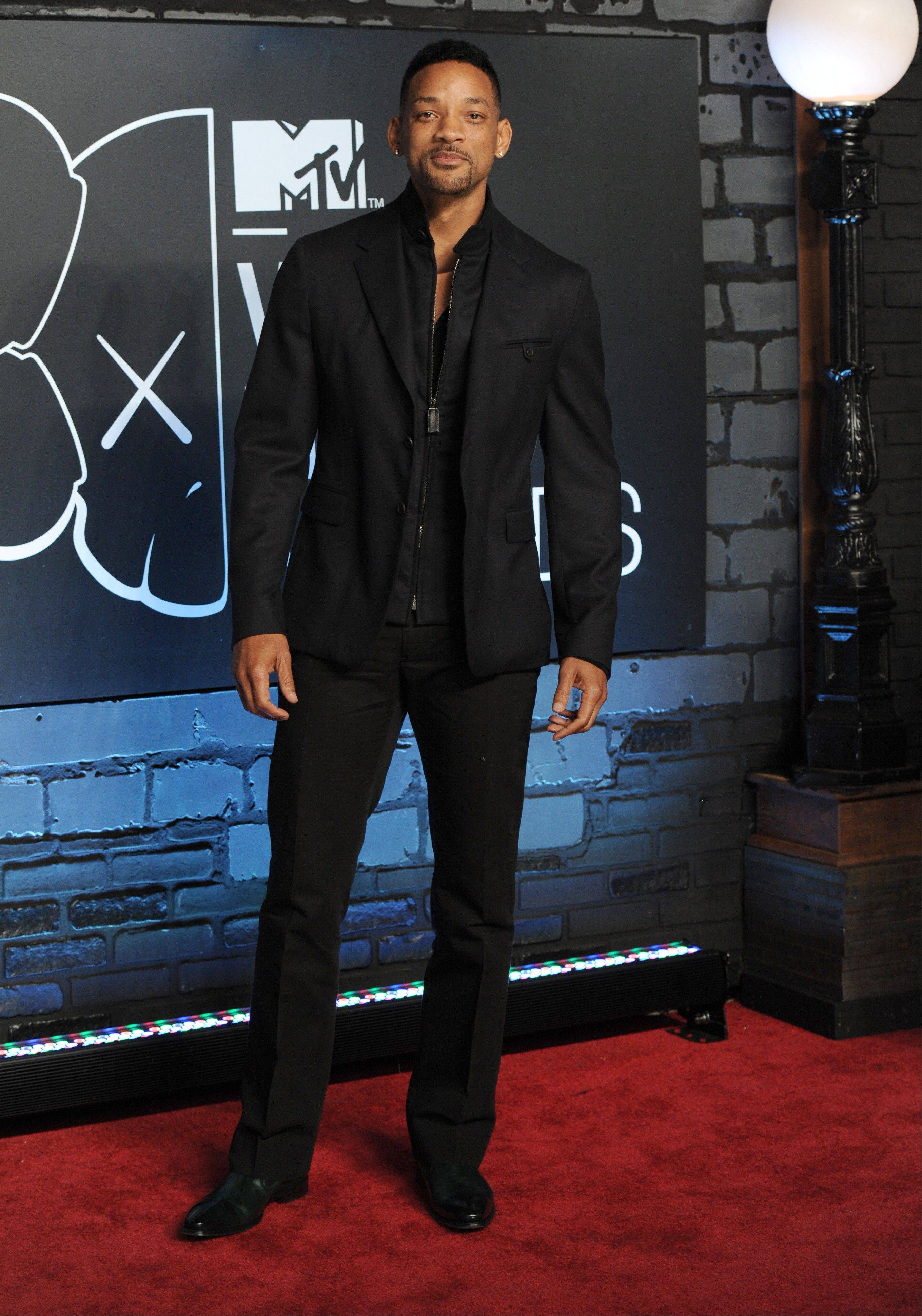 Will Smith arrives at the MTV Video Music Awards on Sunday, Aug. 25, 2013, at the Barclays Center in the Brooklyn borough of New York.