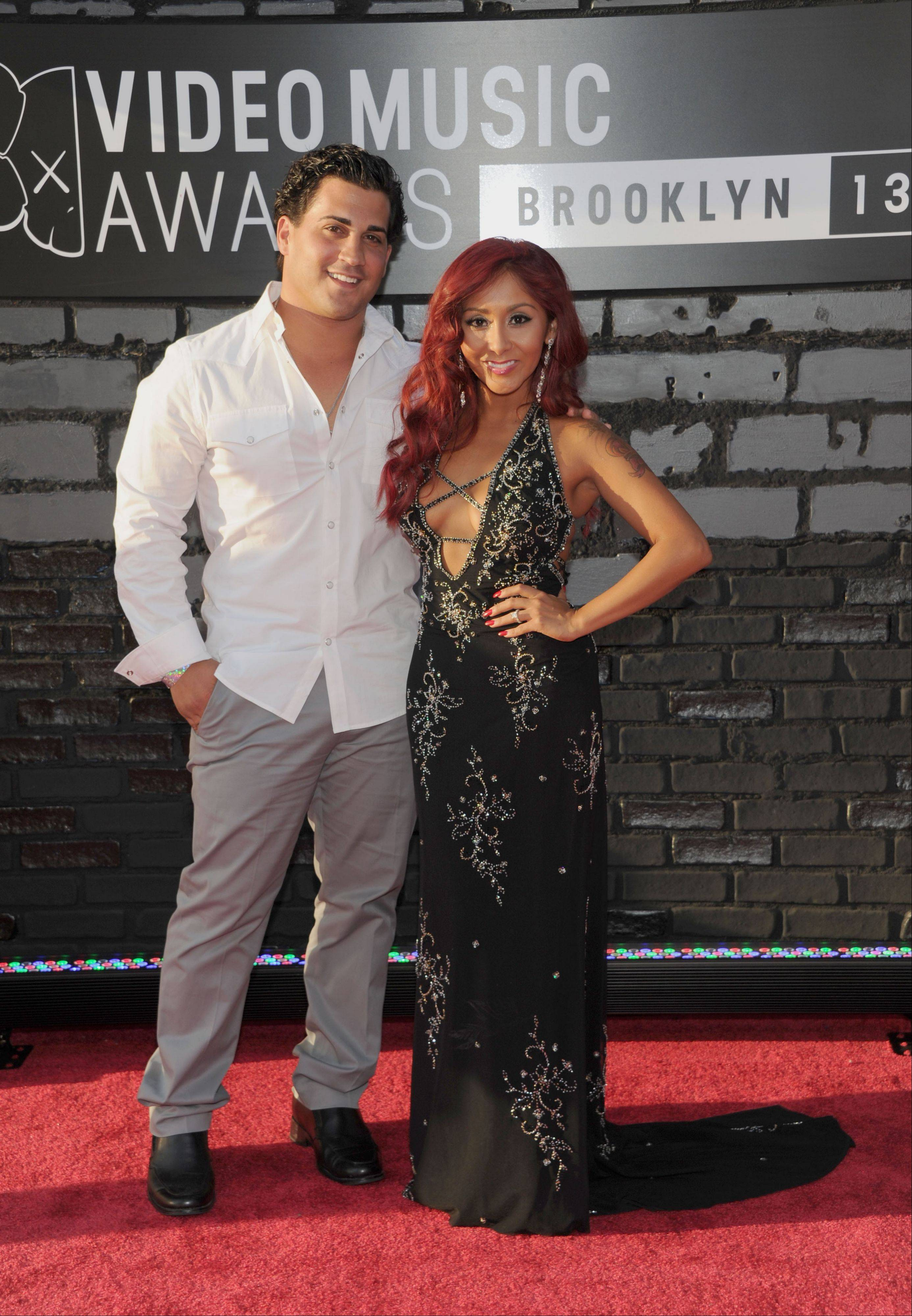 "Jionni LaValle, left, and Nicole ""Snooki"" Polizzi arrive at the MTV Video Music Awards on Sunday, Aug. 25, 2013, at the Barclays Center in the Brooklyn borough of New York."