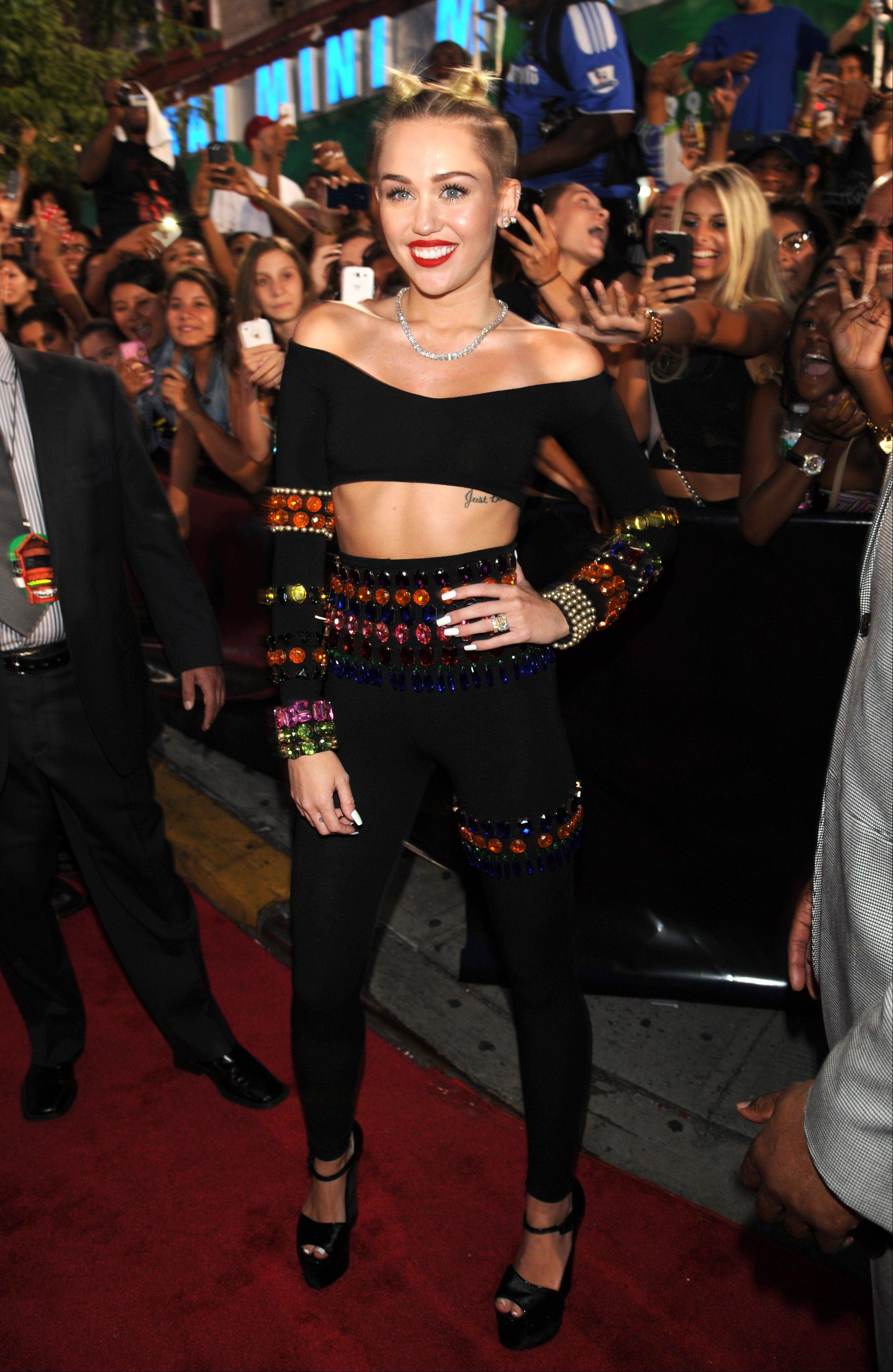 Miley Cyrus arrives at the MTV Video Music Awards on Sunday, Aug. 25, 2013, at the Barclays Center in the Brooklyn borough of New York.