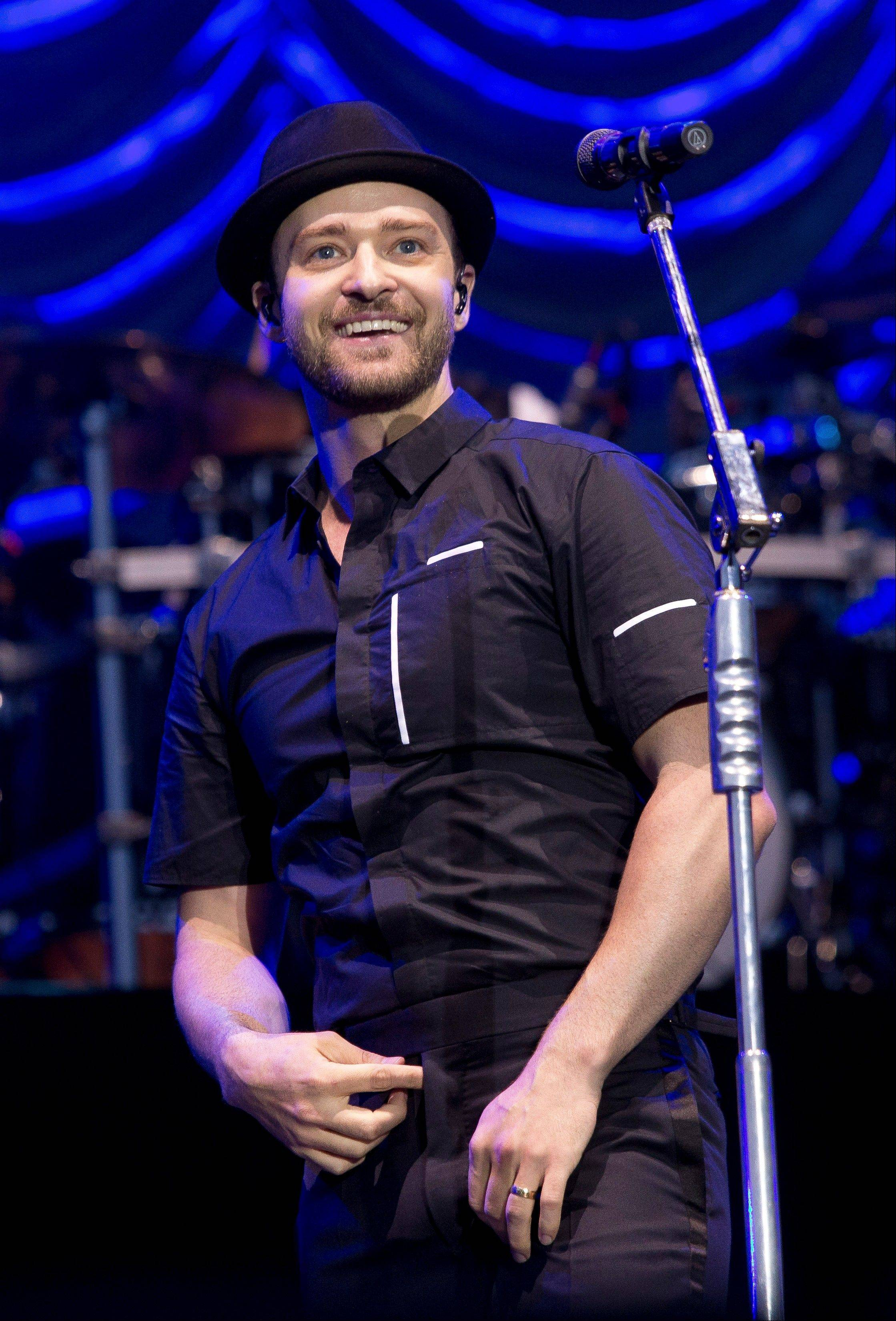 In this July 12, 2013, file photo, Justin Timberlake performs on stage during the Wireless Festival at the Queen Elizabeth Olympic Park in London. This year's MTV Video Music Awards is all about looking forward as artists with some of the fall's most anticipated new music line up to perform as the show makes its first stop in New York's Brooklyn borough. Timberlake and fellow lead nominees Macklemore & Ryan Lewis are scheduled to perform, but that's just the start Sunday night, Aug. 25, 2013, at the Barclays Center, where the show kicks off at 9 p.m. EDT.