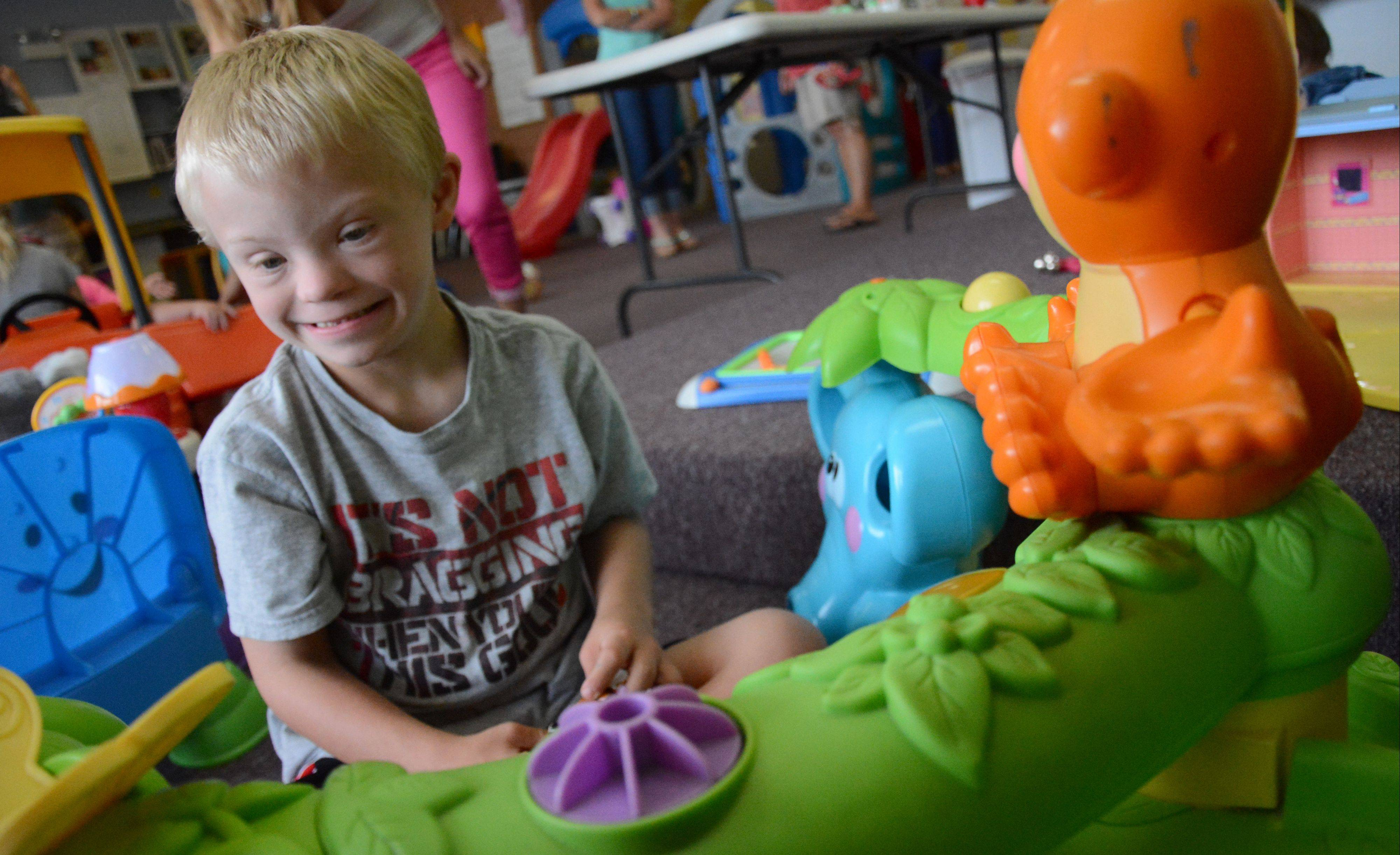 Cody Huston, 6, of Naperville plays with a toy during open playtime at GiGi's Playhouse in Hoffman Estates.To accommodate growing interest in GiGi's Playhouses across the nation, a National Achievement Center is being built.