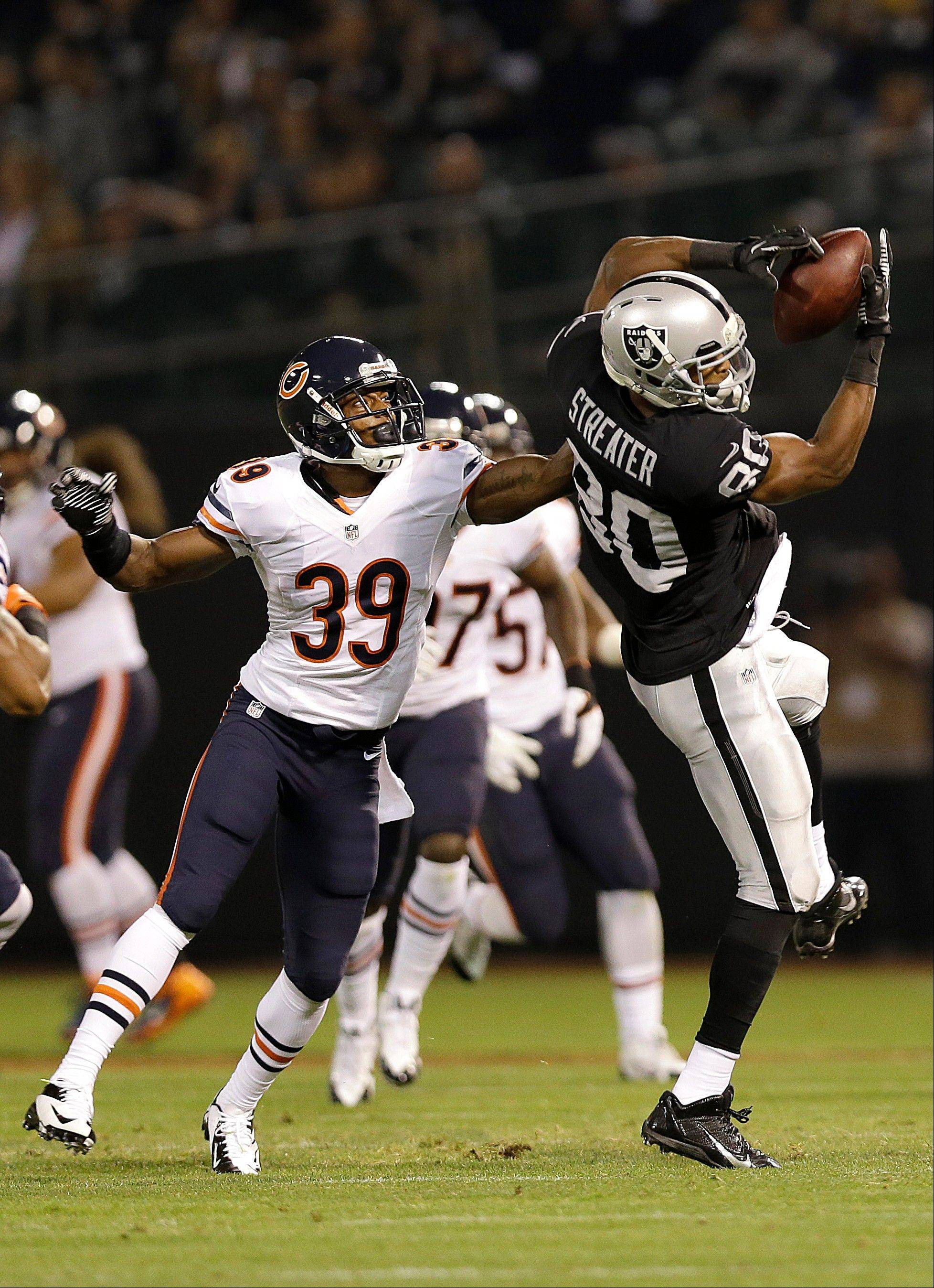 Oakland Raiders wide receiver Rod Streater (80) catches a pass over Chicago Bears cornerback C.J. Wilson (39) during the third quarter of an NFL preseason football game in Oakland, Calif., Friday. Wilson is in a battle with Demontre Hurst and Sherrick McManis for a roster spot.