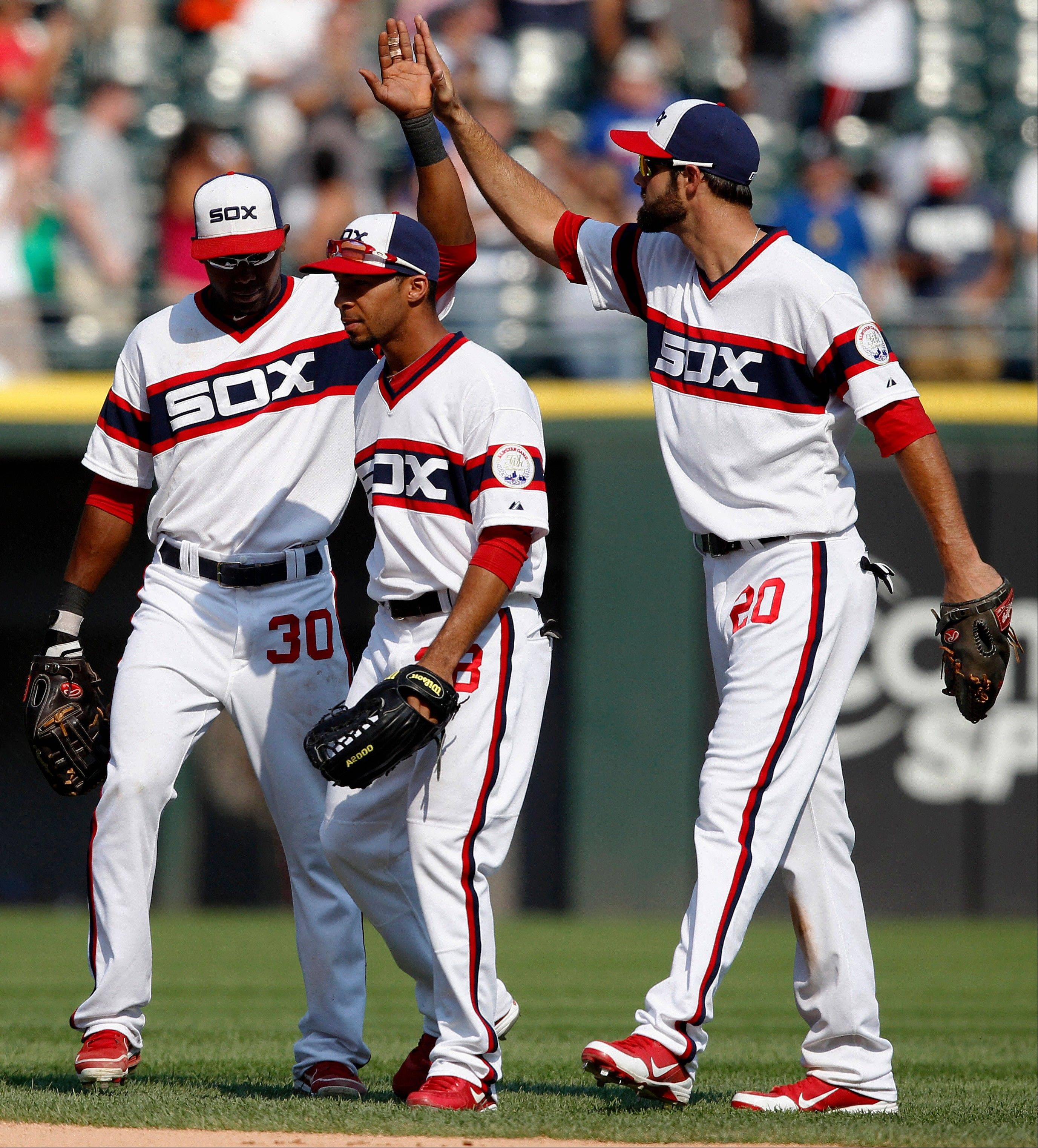 Alejandro De Aza, left, Leury Garcia and Jordan Danks celebrate the White Sox' 5-2 victory over the Texas Rangers at U.S. Cellular Field on Sunday.