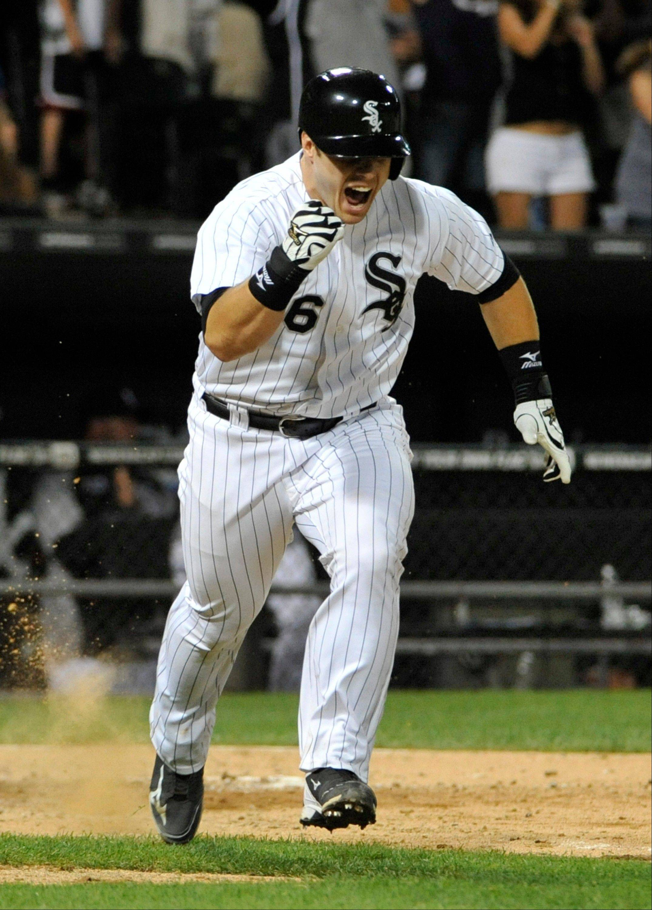 The White Sox' Josh Phegley reacts to hitting the game-winning hit against the Texas Rangers during the ninth inning Saturday, Aug. 24, 2013, in Chicago.