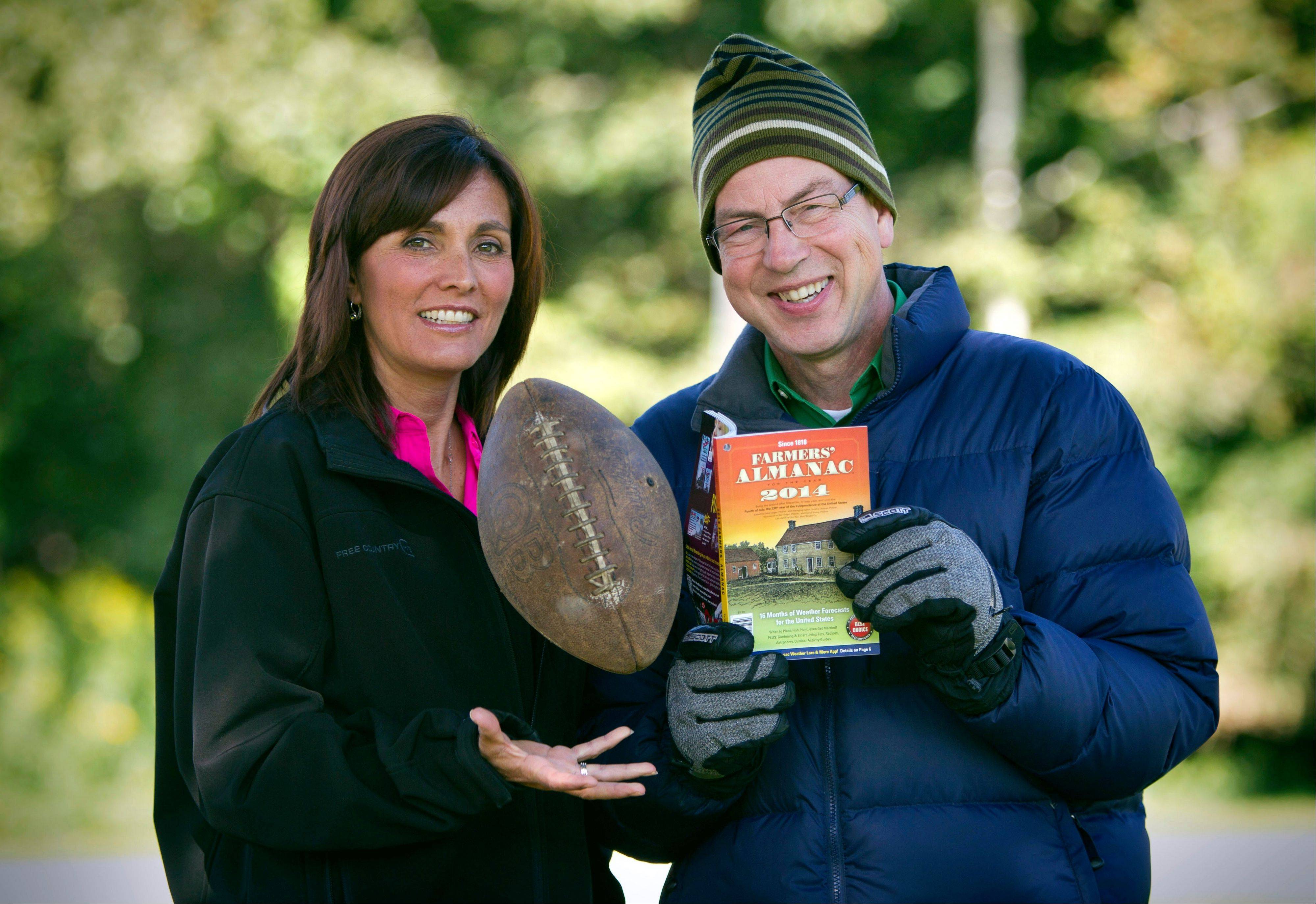 Farmers� Almanac managing editor Sandy Duncan, left, and editor Peter Geiger, with the latest edition. The 197-year-old almanac is predicting a colder-than-normal winter for most of the United States.