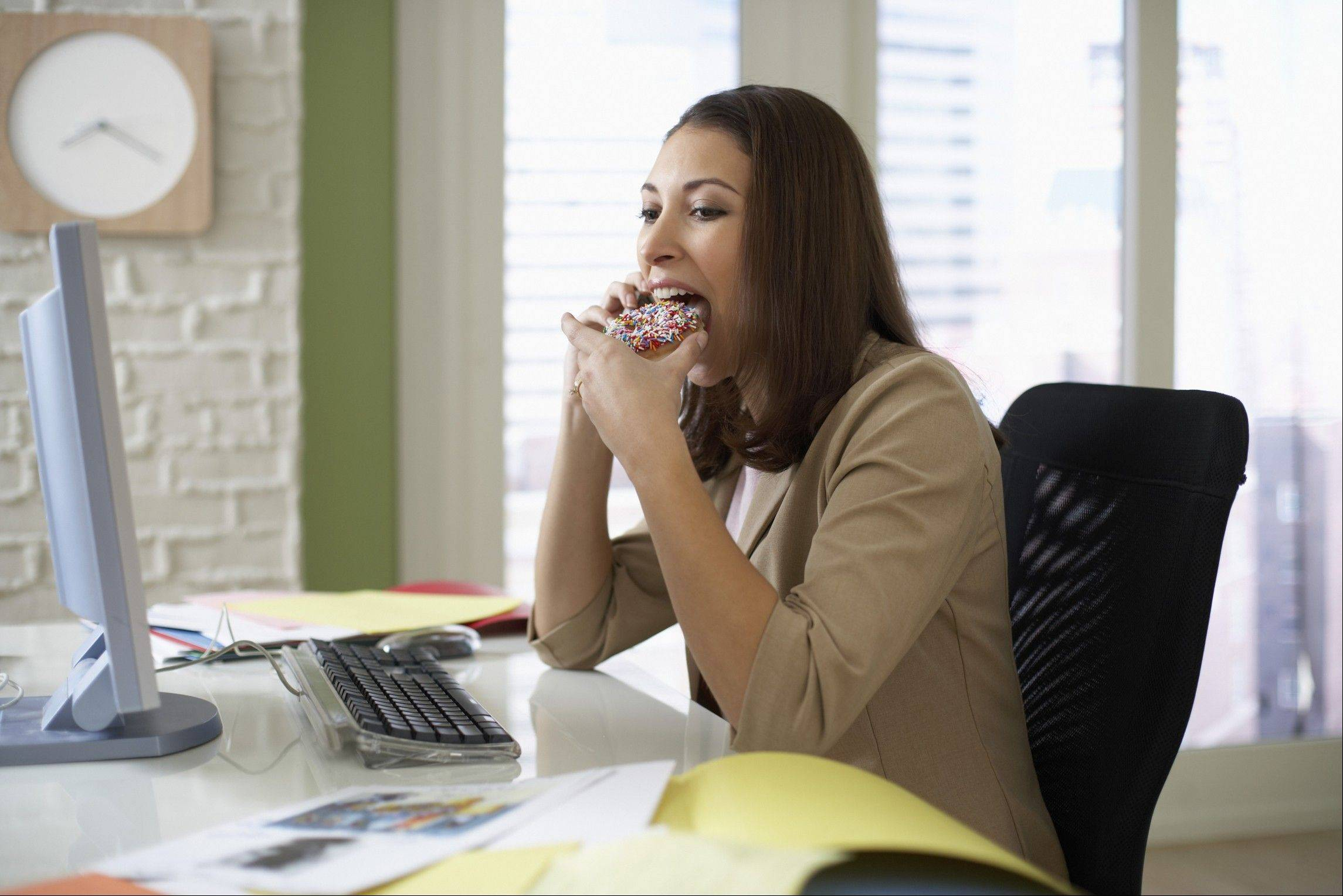 Eating junk food or unhealthy snacks at work can add to the waistline.