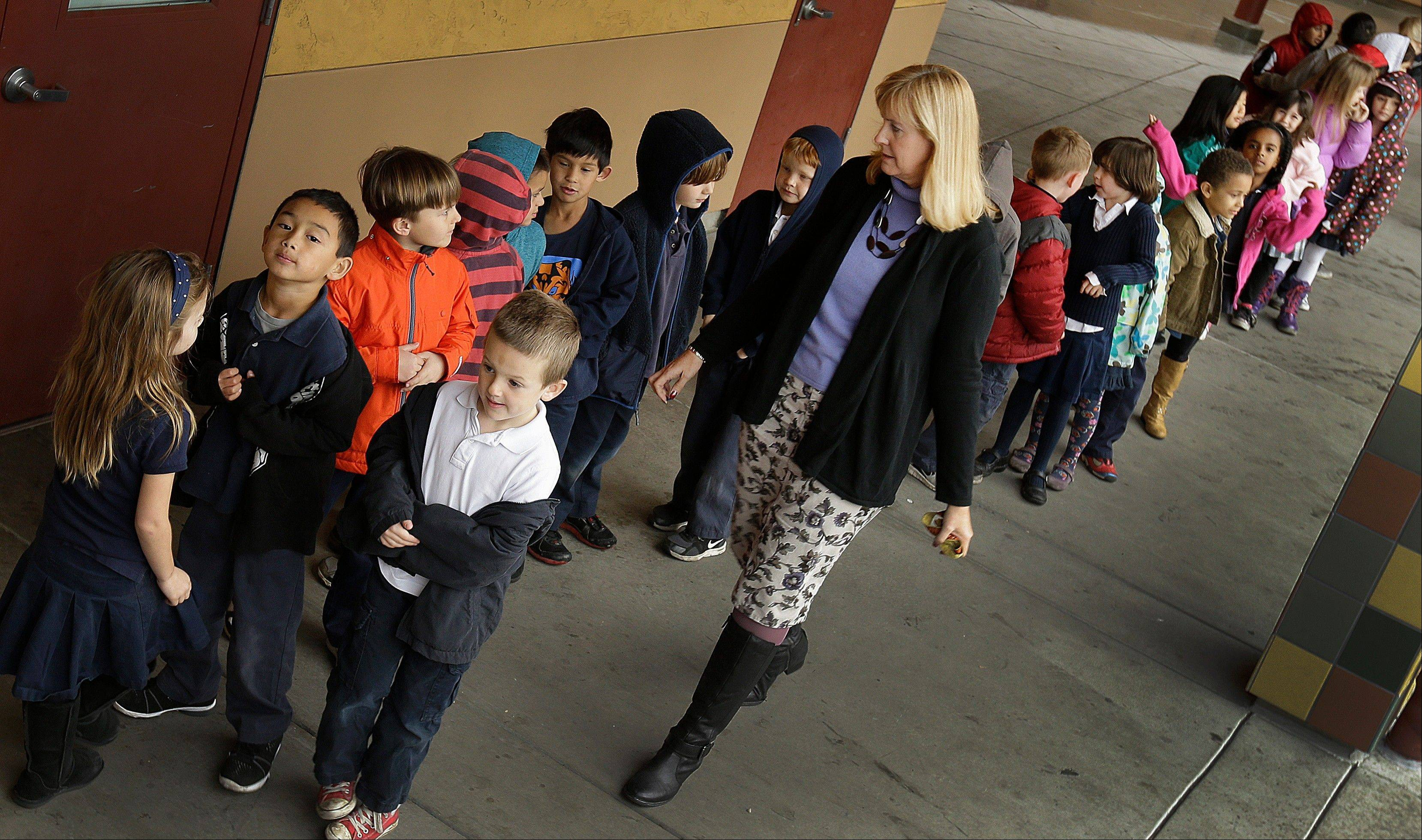 First grade teacher Lynda Jensen walks with her class of 30 children at Willow Glenn Elementary School in San Jose, Calif. The Common Core State Standards have been adopted by 45 states and the District of Columbia with the goal of making sure the nation�s high school graduates leave school ready for college or a job.
