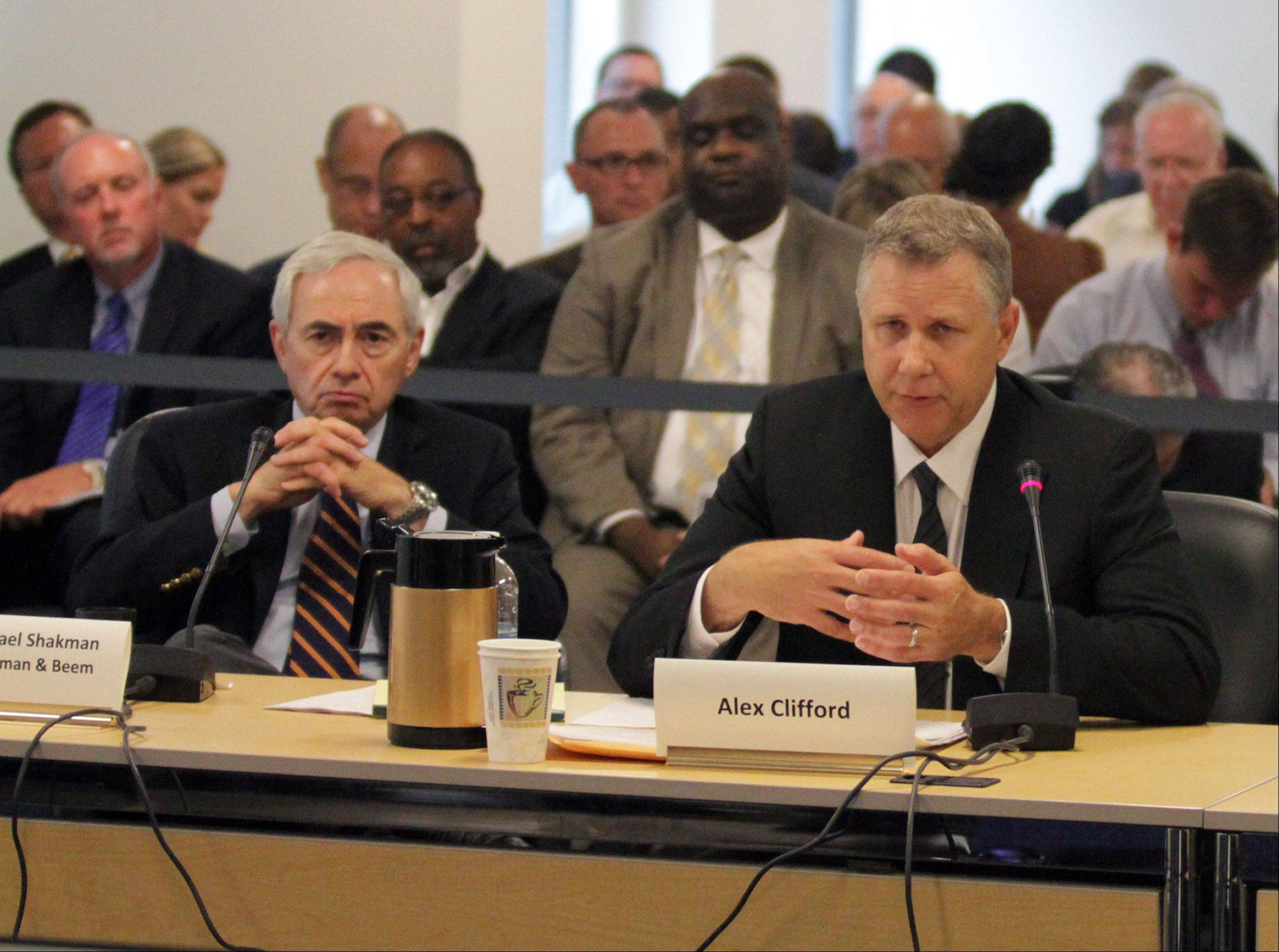 Daily Herald File Photo Former Metra CEO Alex Clifford, right, testified at an RTA hearing in July with his attorney Michael Shakman, left. Sitting a row behind is former Chairman Brad O'Halloran, far left.