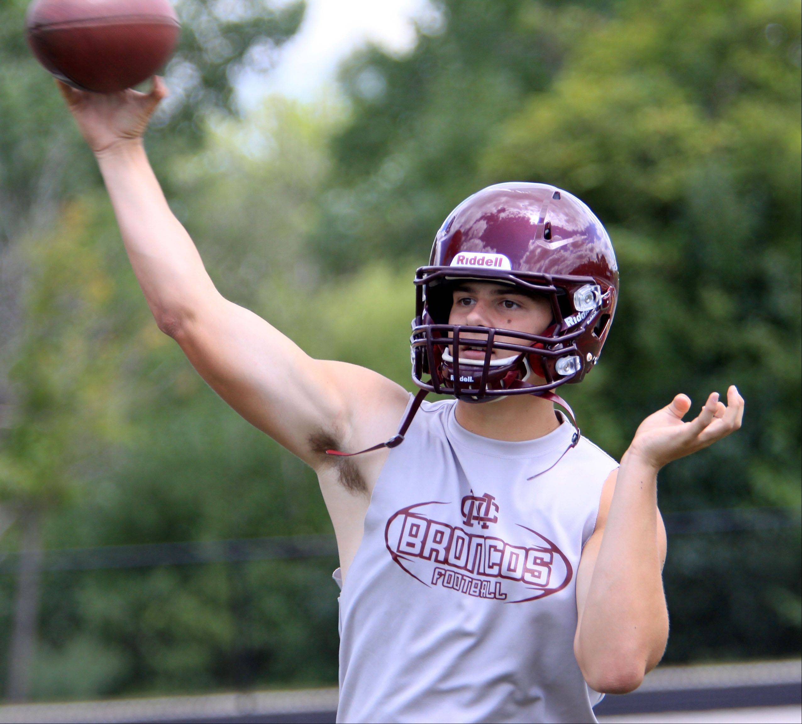 Quarterback Alex Wills will lead Montini into action Friday night in Lombard against Maine South.