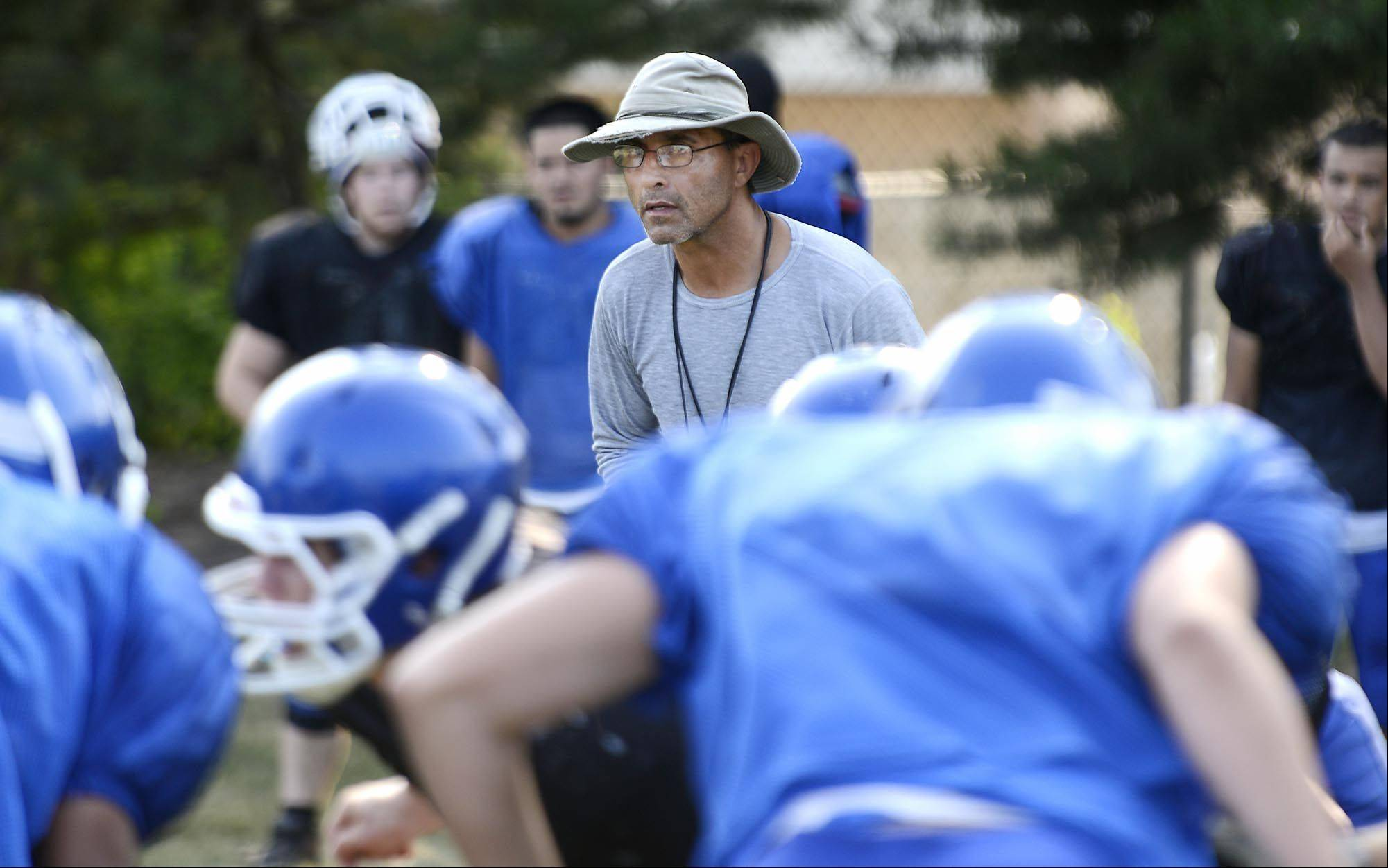 Head coach Vito Andriola watches his Dundee-Crown football team at a recent practice.