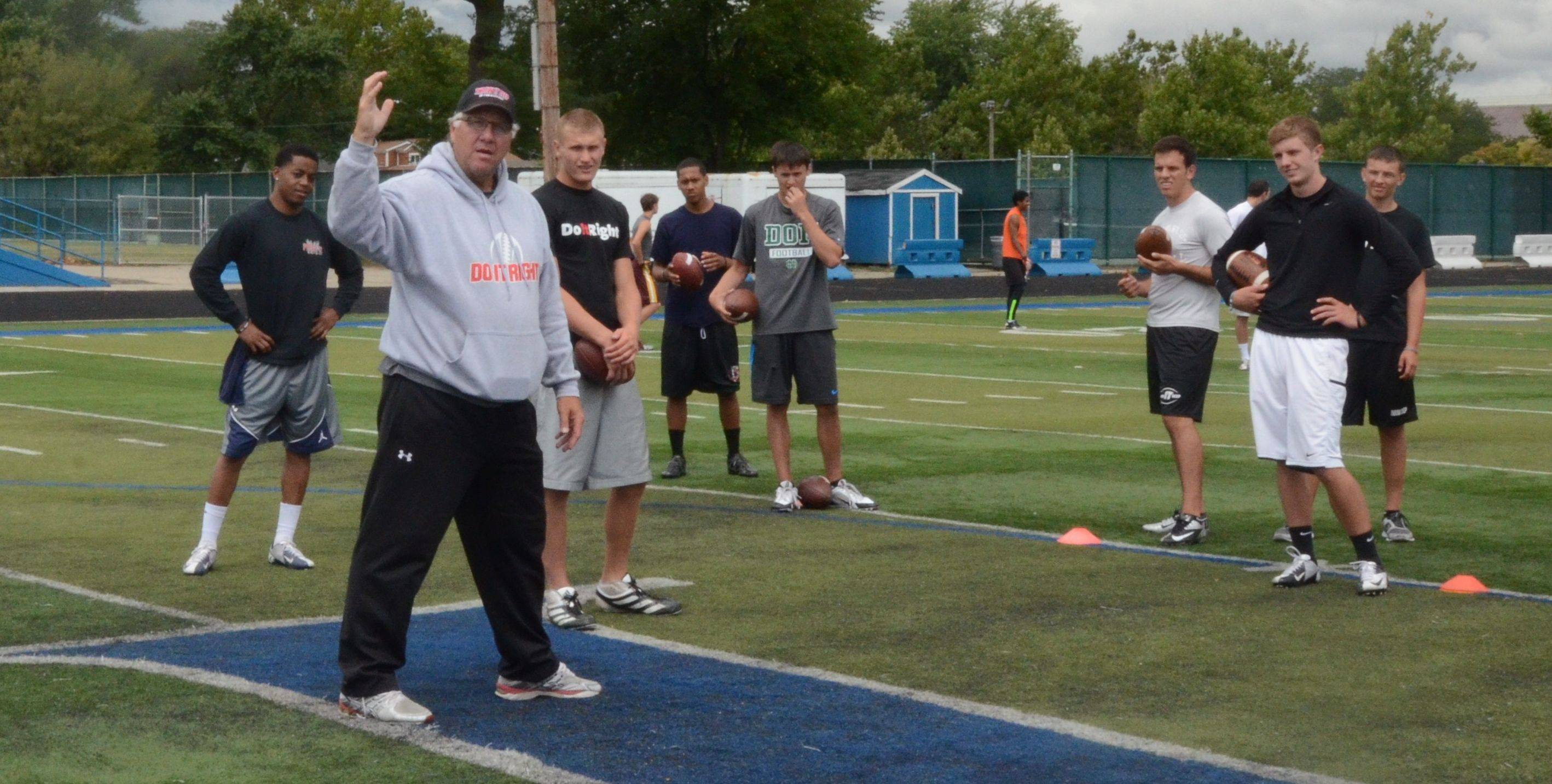 Quarterbacks coach Jeff Christensen, here working with high school and college-bound players, has received high praise for his training camp results. Matt Blanchard of the Bears credits Christensen with getting him to the next level.