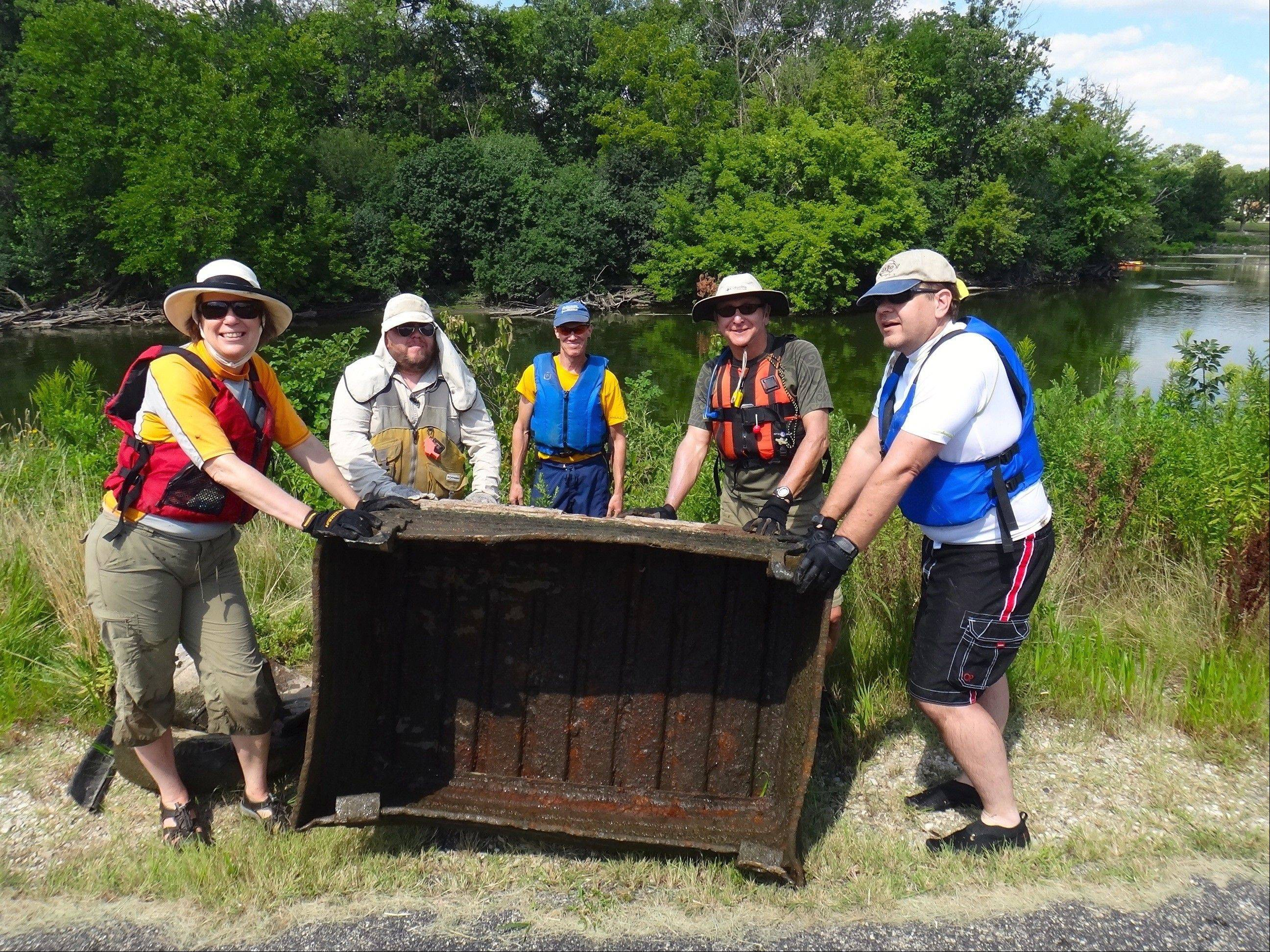 Diane Osgood, from left, Tom Eckels, Doug Bosco, Jim Berg and Gregg Szulczynski, all from the Prairie State Canoeists, helped to clean up the Fox River.