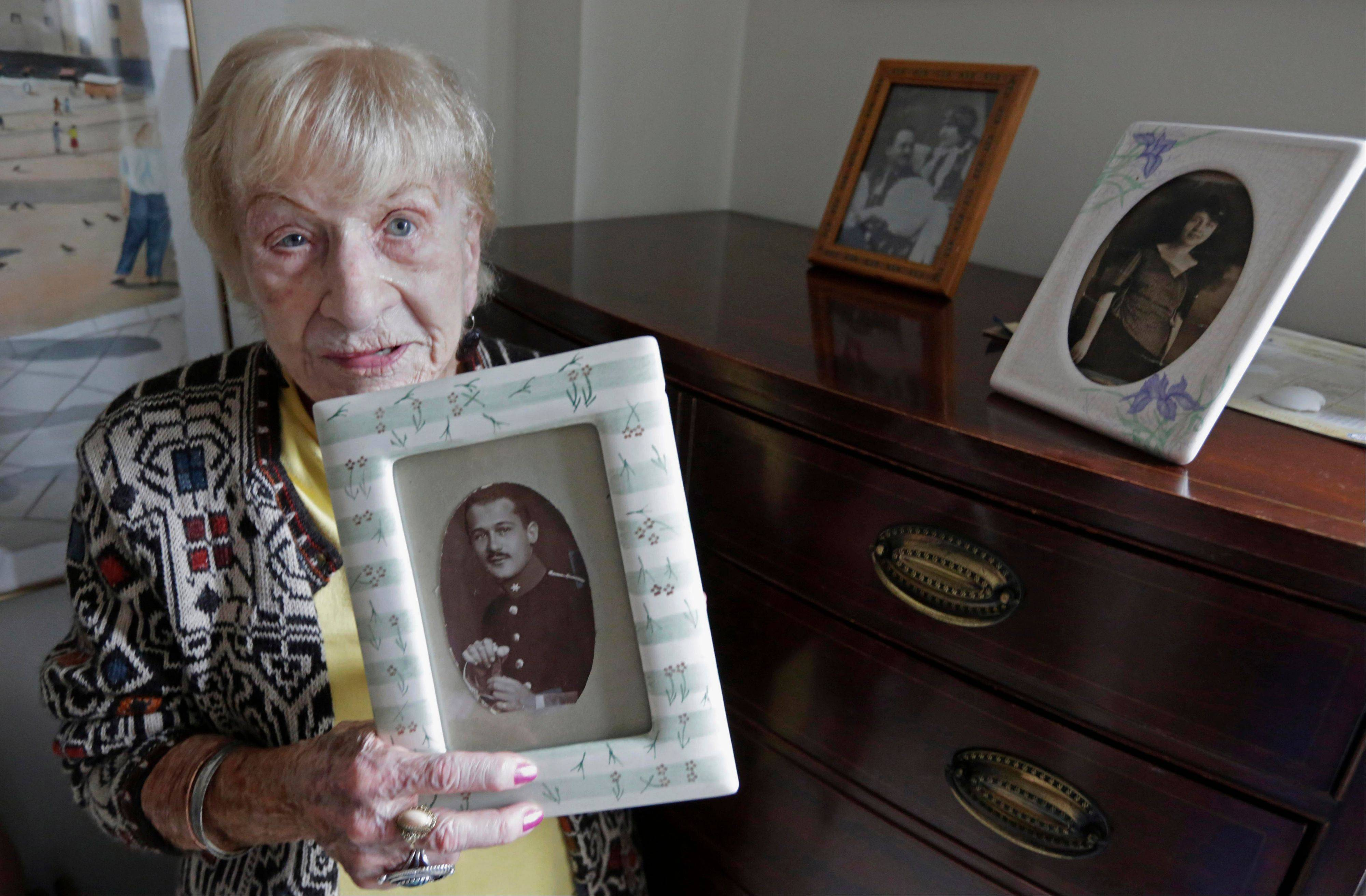 Edith Stern, 92, holds a photo of her father in her studio apartment at a retirement home in Chicago. Stern who is originally from Czechoslovakia lost her parents and her husband in the Holocaust.