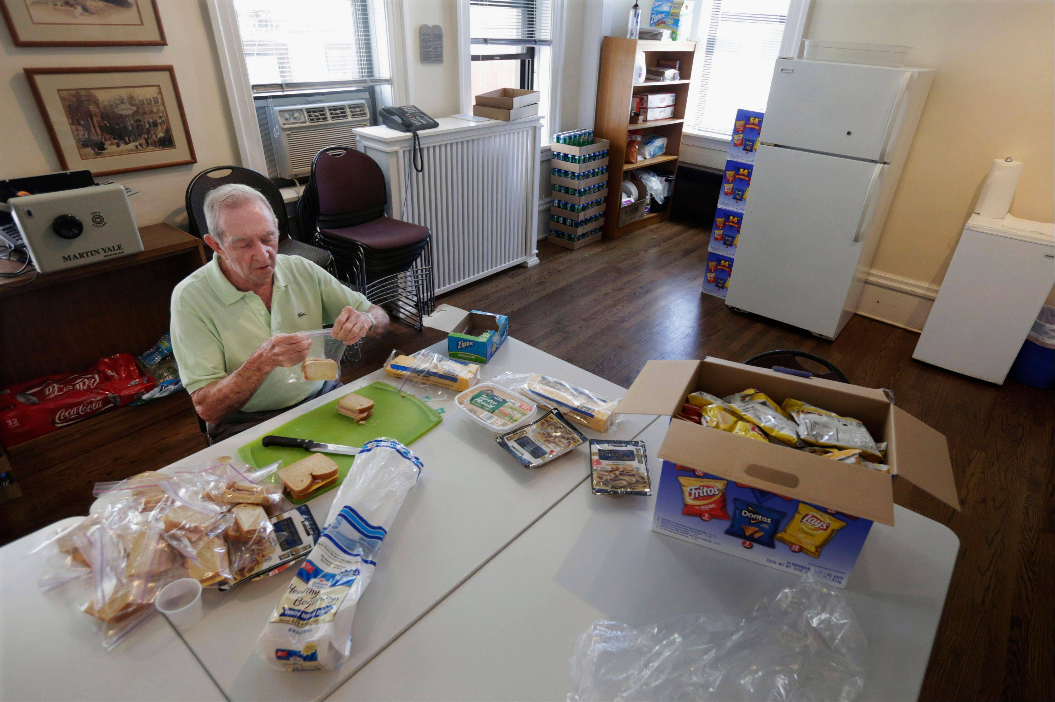 "Don Tenbrunsel, 85, a soup kitchen volunteer, makes lunches at St. Josaphat's Church in Chicago. Tenbrunsel is a ""super ages,"" participating in a Northwestern University study of people in their 80s and 90s with astounding memories."