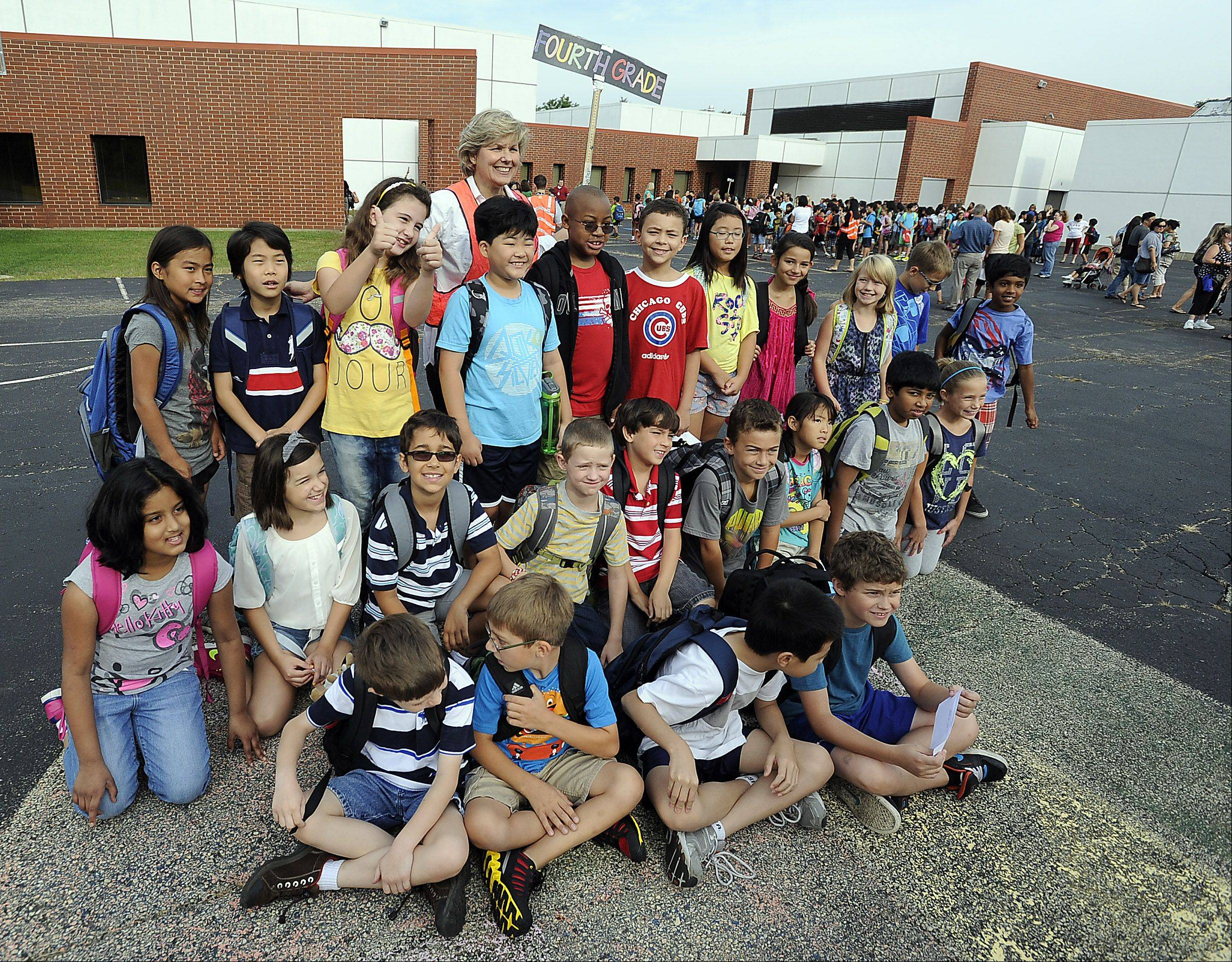 Kathy McAvoy's fourth-grade class takes a picture on the first day of school Monday at Frank C. Whiteley Elementary School in Hoffman Estates.