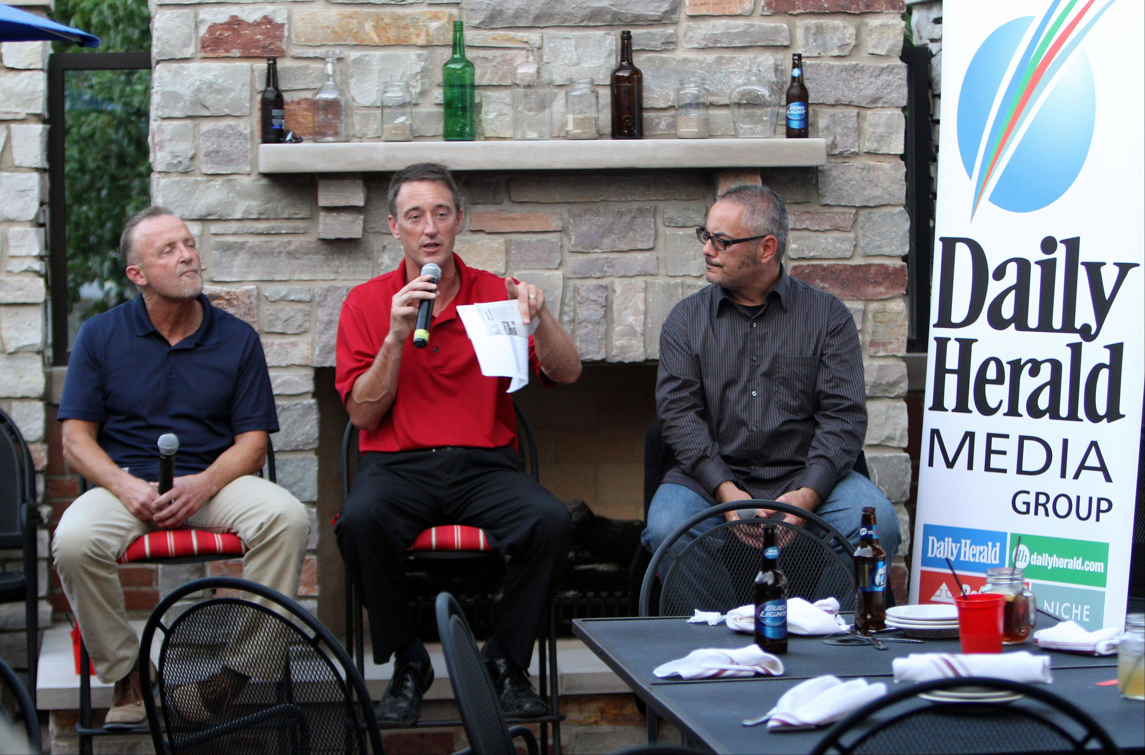 From left, Bears beat writer Bob LeGere, fantasy football columnist John Dietz, and and sports writer Joe Aguilar participate in a Daily Herald-hosted Fantasy Football preview event for about 100 subscribers Monday at Rack House Kitchen and Tavern in Arlington Heights.