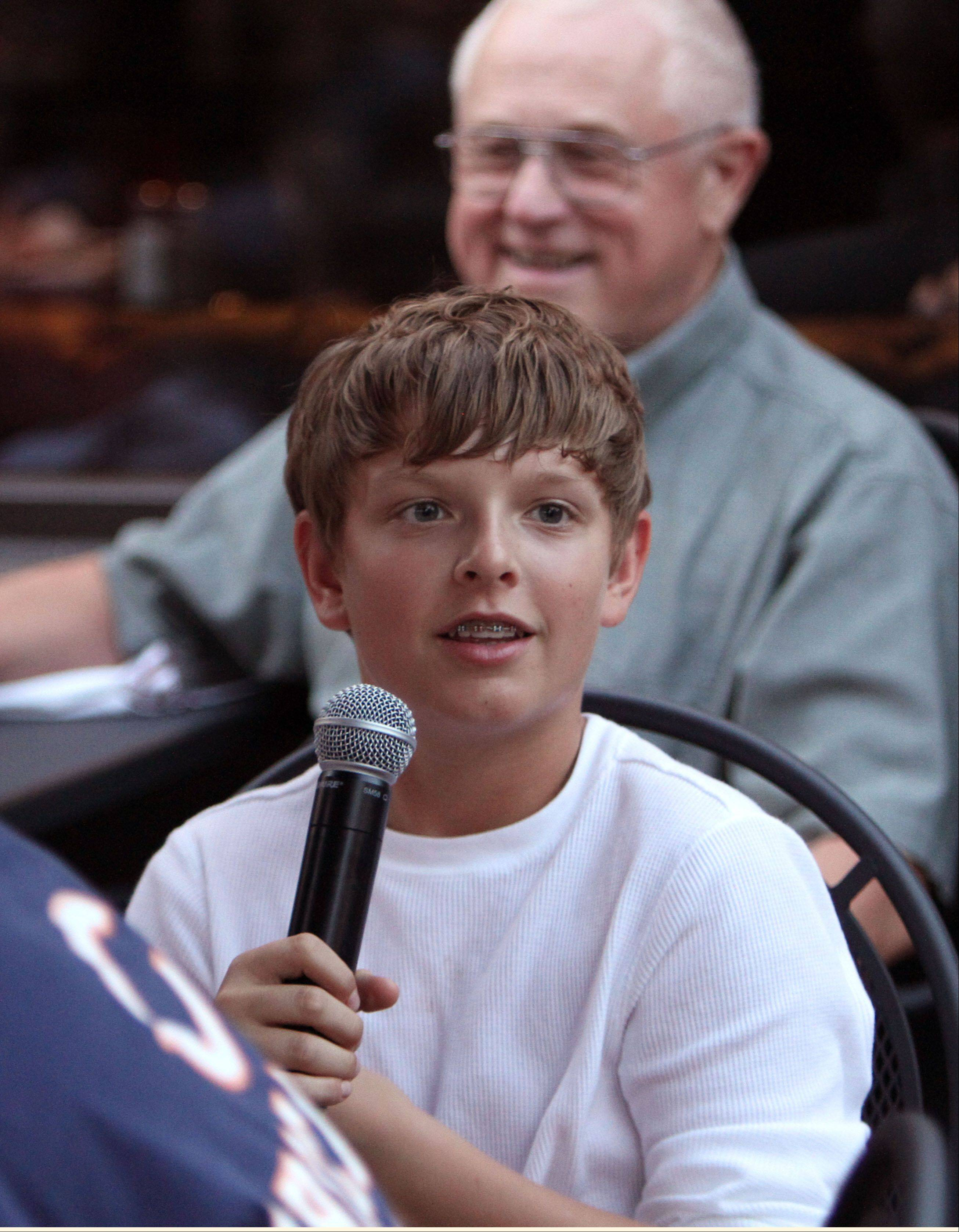 Thirteen-year-old Matt Grabianski of Palatine asks a question Monday during a Fantasy Football preview event hosted by Daily Herald columnist John Dietz, Bears beat writer Bob LeGere and sports writer Joe Aguilar at Rack House Kitchen and Tavern in Arlington Heights.