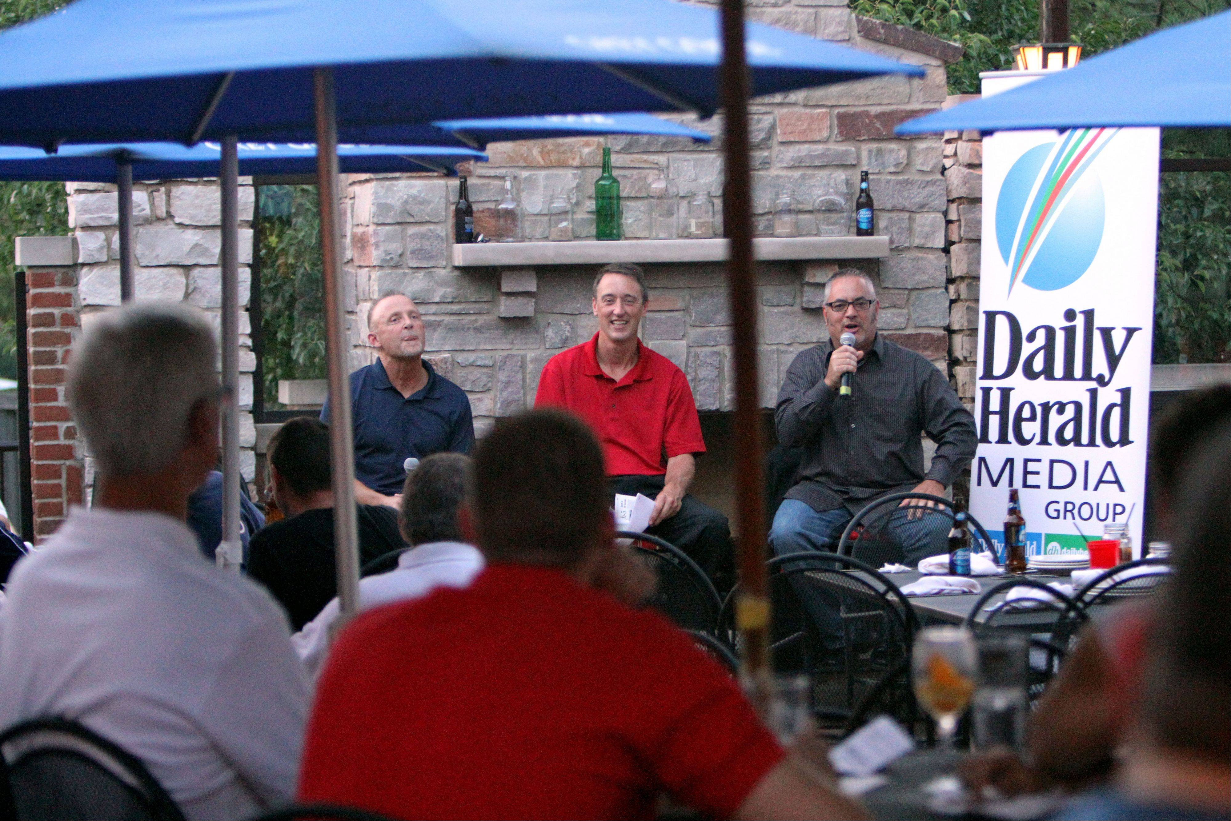 From left, Bears beat writer Bob LeGere, fantasy football columnist John Dietz, and and sports writer Joe Aguilar participate in a Daily Herald hosted Fantasy Football preview event Monday for about 100 subscribers at Rack House Kitchen and Tavern in Arlington Heights.