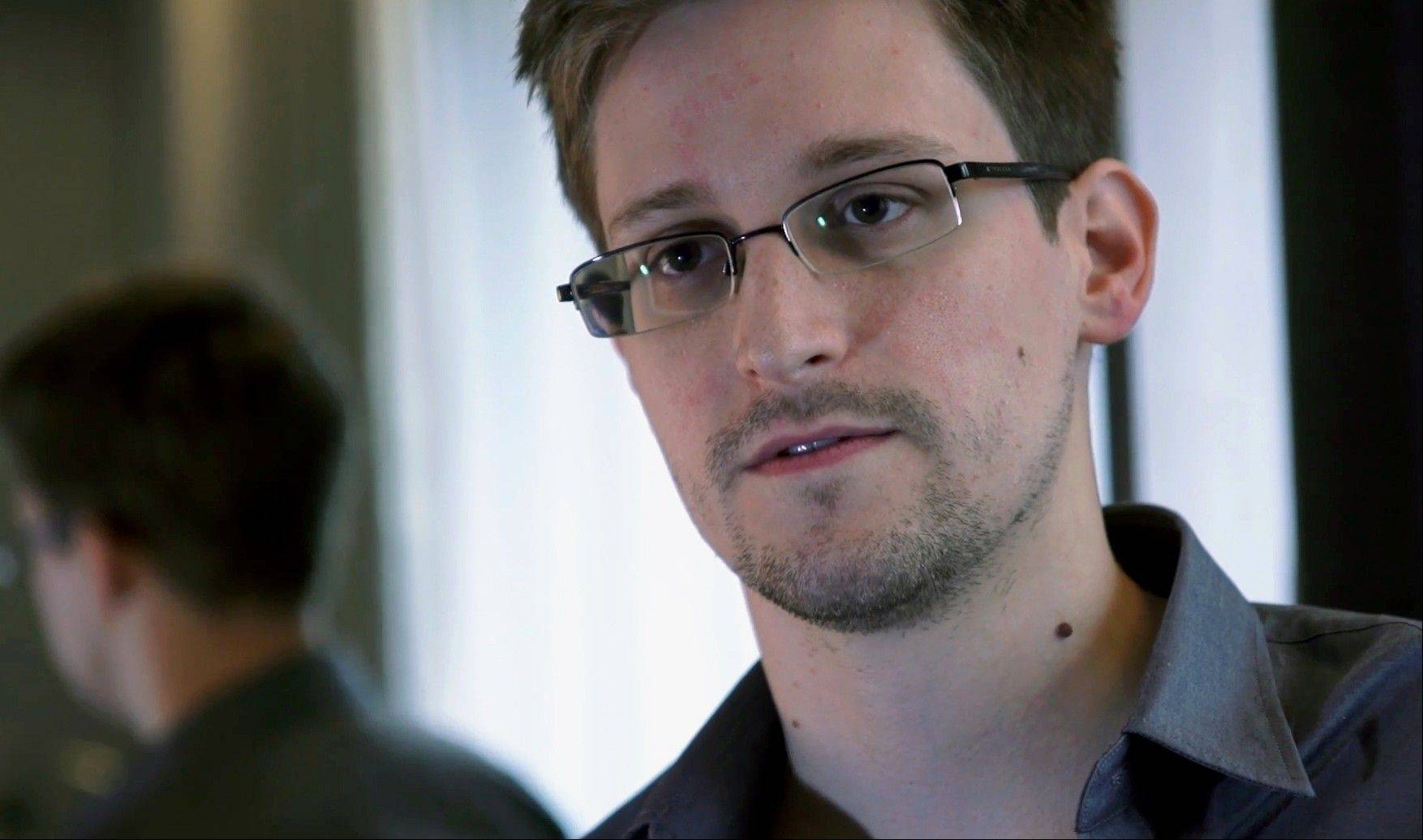 NSA leaker Edward Snowden spent two days in the Russian Consulate in Hong Kong directly before flying to Moscow on what turned out to be an abortive attempt to reach asylum in Latin America, the respected newspaper Kommersant reported Monday, citing unidentified sources in Snowden's circle and the Russian government.