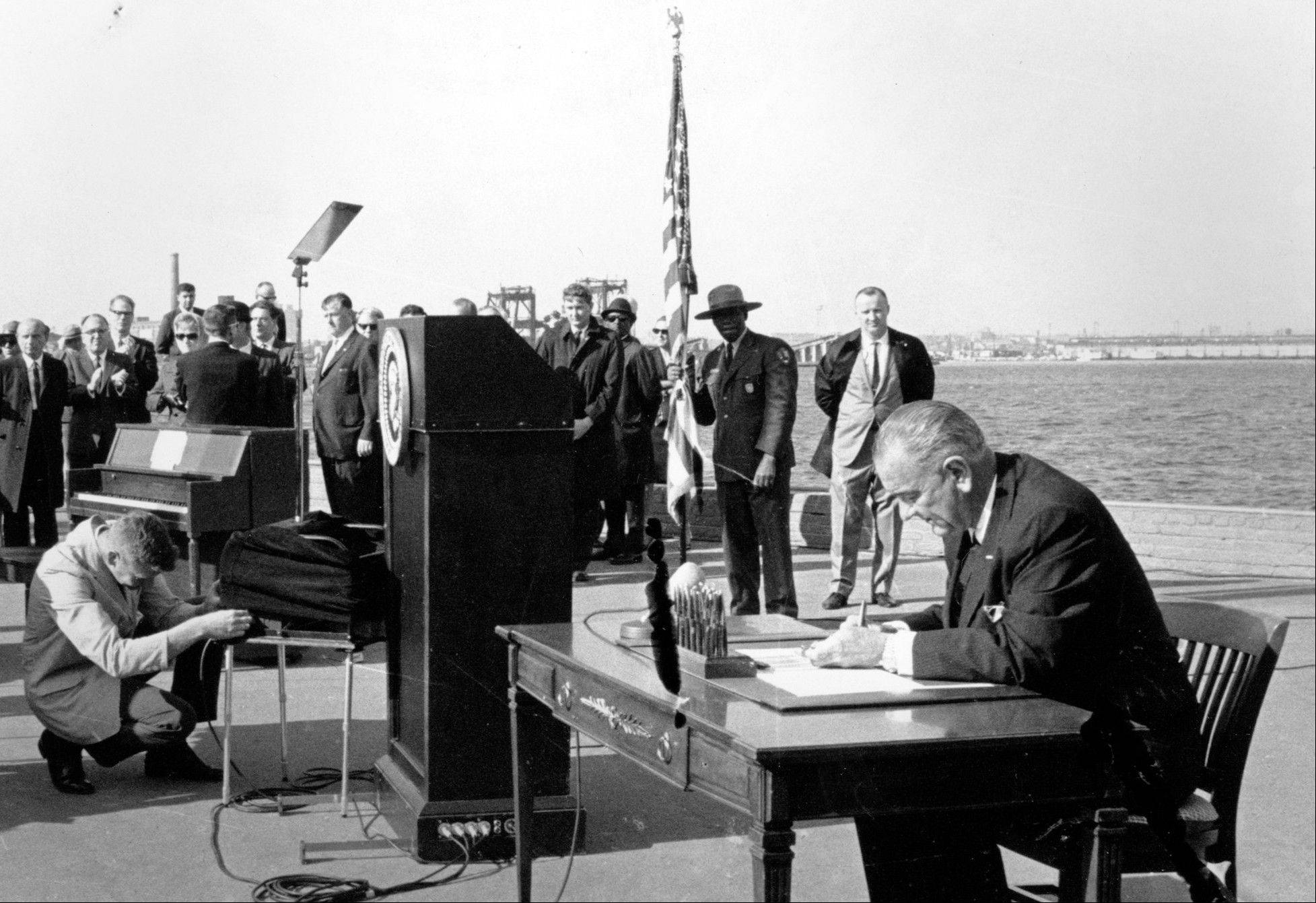 On Oct. 3, 1965, U.S. President Lyndon B. Johnson sat at his desk on Liberty Island in New York Harbor as he signed a new immigration bill. It was in 1965 that the U.S. government radically changed its immigration policy, and planted the seeds for America's current demographic explosion, a shift that historians say happened in part because of a hunger for change and equality created by the civil rights movement.