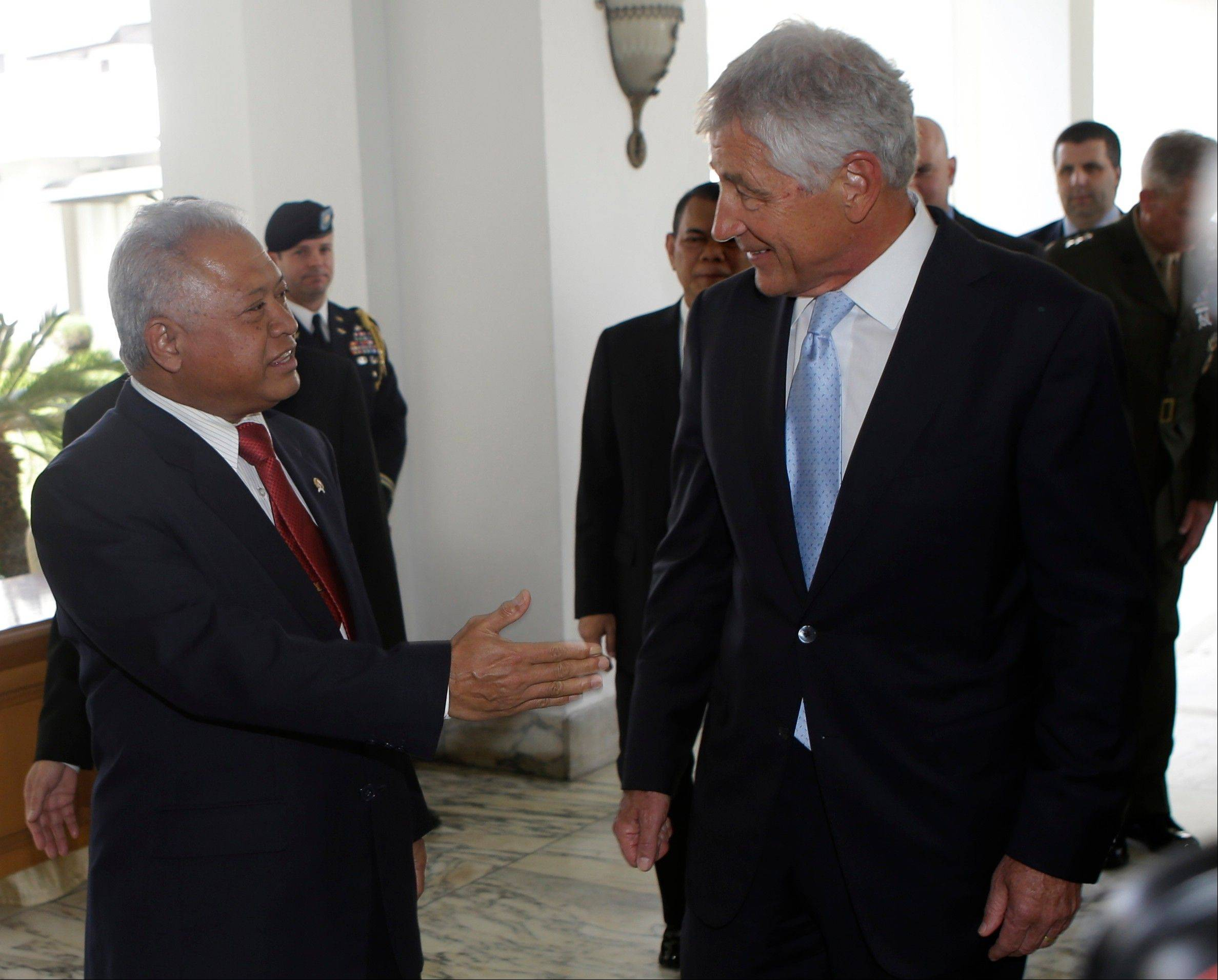 "U.S. Defense Secretary Chuck Hagel, right, who is talks with Indonesian Defense Minister Purnomo Yusgiantoro Monday, said the Obama administration was studying intelligence on Syria's purported use of chemical weapons and ""will get the facts"" before acting."