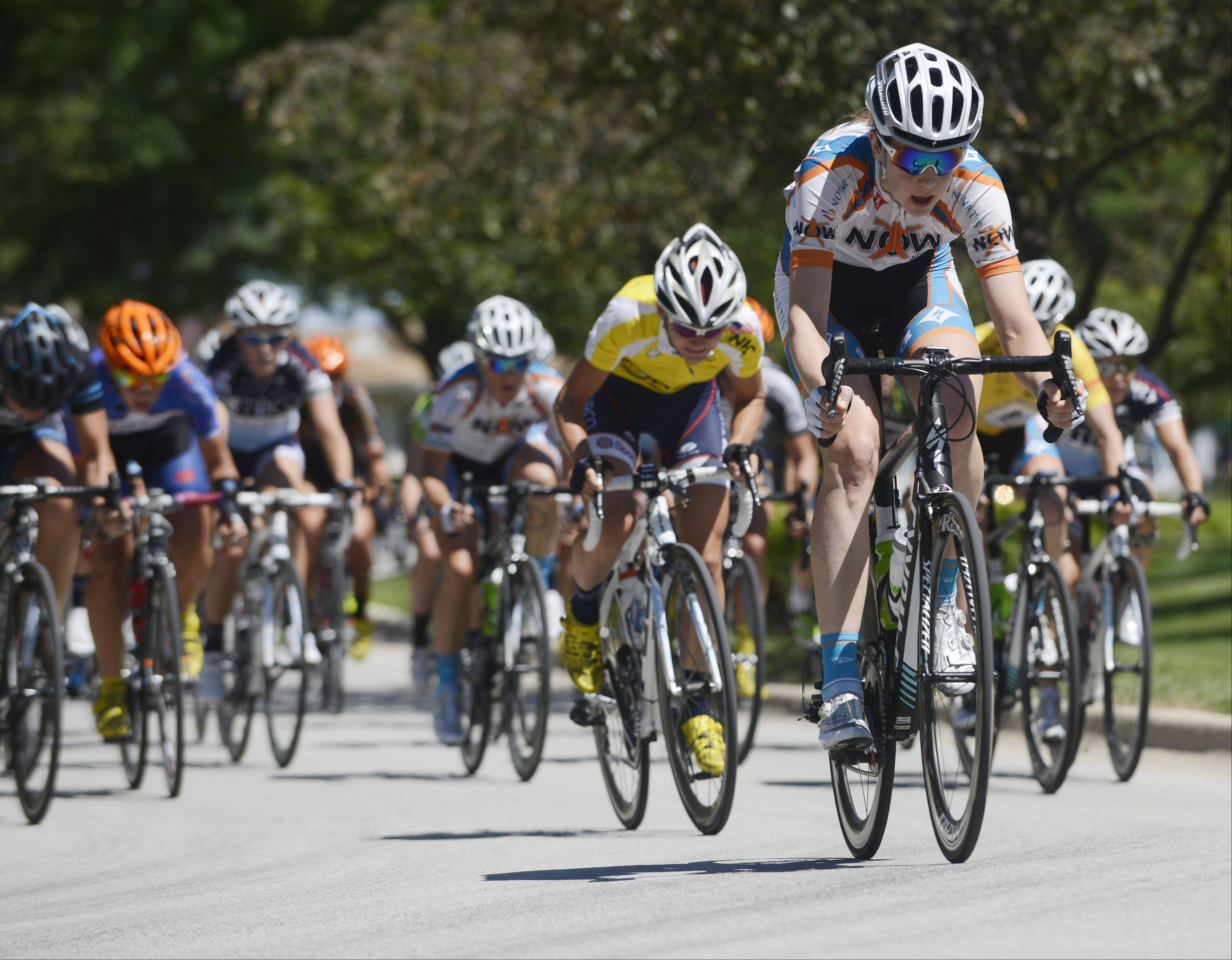 Riders pick up speed on the Elk Grove Boulevard during stage two of the women's pro three-day, three stage race, a 45.3-mile criterium, of the Tour of Elk Grove Saturday.