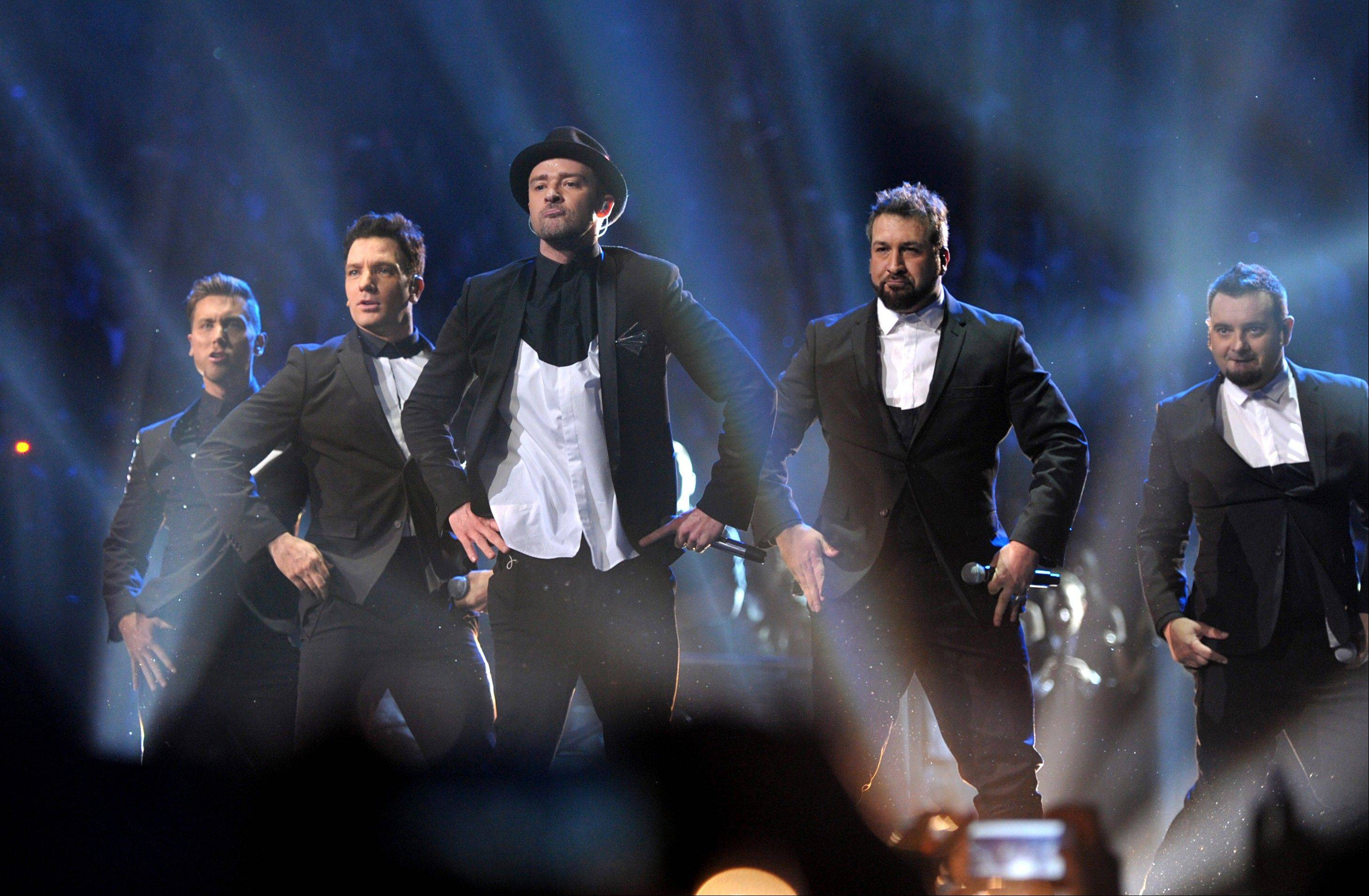 This image released by MTV shows, from left, Lance Bass, JC Chasez, Justin Timberlake, Joey Fatone and Chris Kirkpatrick, of 'N Sync, during a performance at the MTV Video Music Awards at Barclays Center on Sunday in the Brooklyn borough of New York.