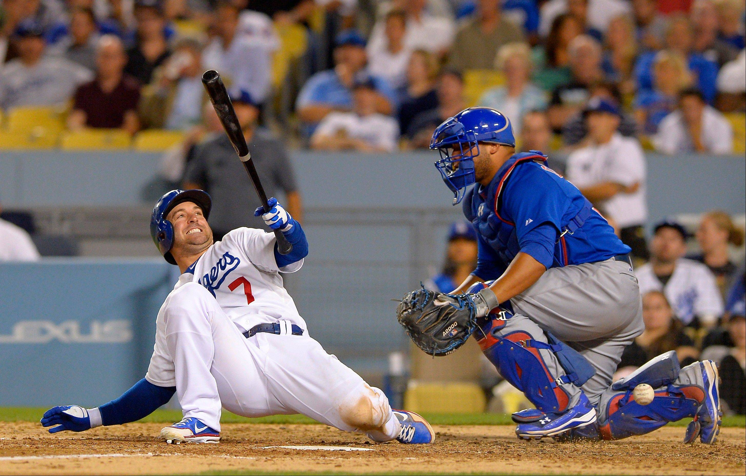 Cubs catcher Welington Castillo watches the Dodgers' Nick Punto hit the deck to avoid being struck by a pitch during the sixth inning Monday night in Los Angeles.