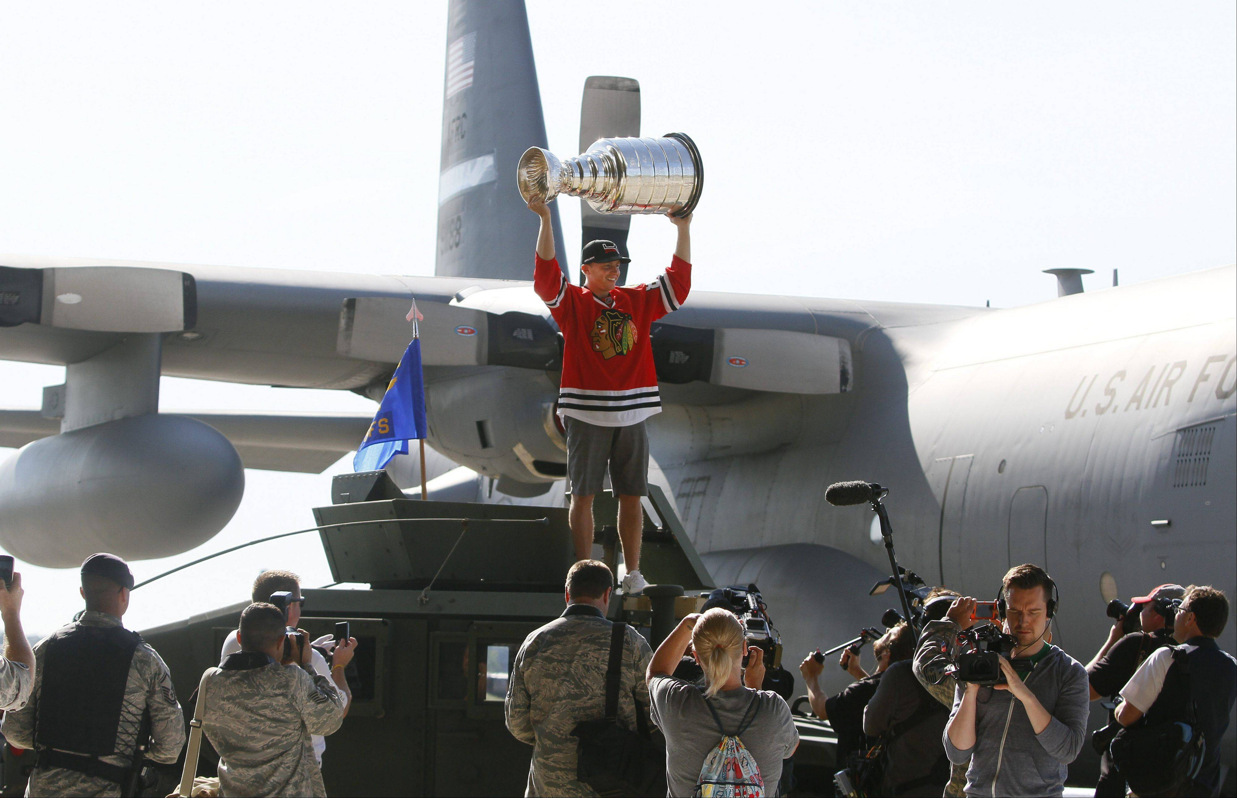 Patrick Kane shows off the Stanley Cup at the Niagara Falls Air Base in the Town of Niagara Saturday, August 24, 2013. (Mark Mulville/Buffalo News)