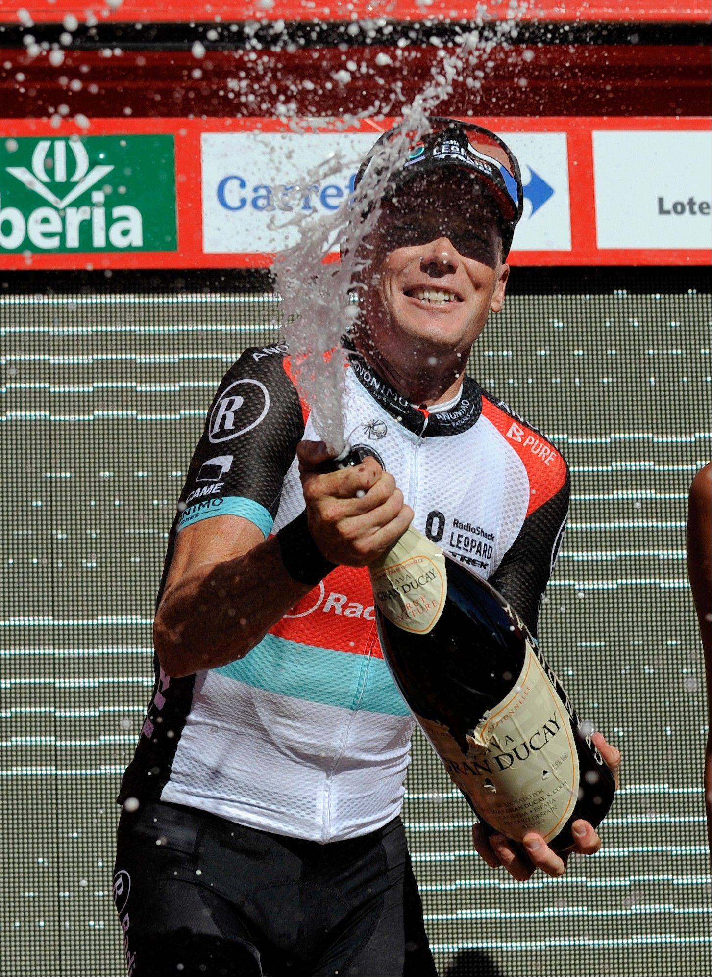 Christopher Horner celebrates on the podium after winning the third stage of the Spanish Vuelta on Monday and taking the overall lead. The 21-stage race ends in Madrid on Sept. 15.