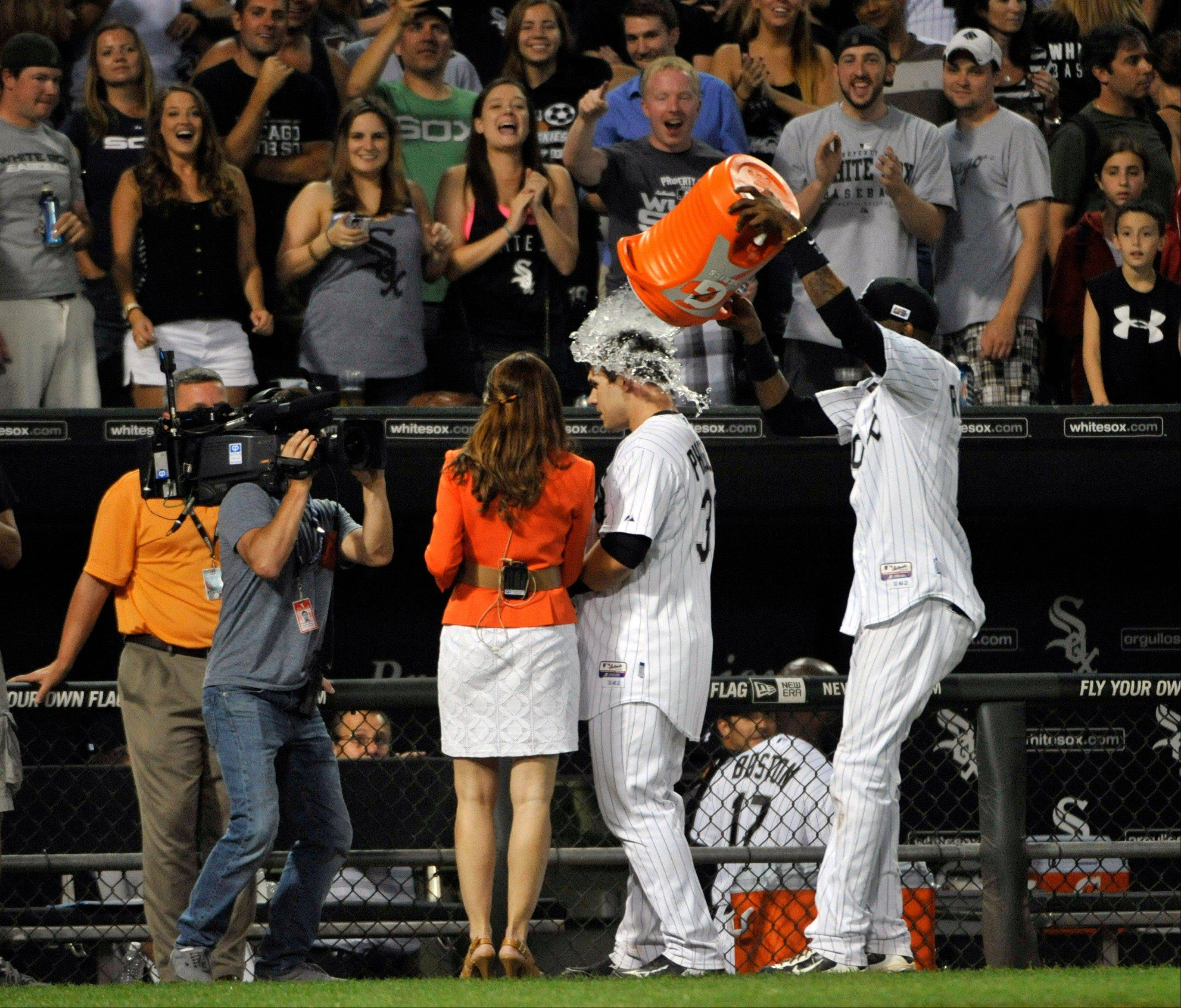 After his game-winning hit Saturday against the Rangers, the White Sox' Josh Phegley gets a Gatorade bath from Alexei Ramirez during a postgame interview at U.S. Cellular Field.