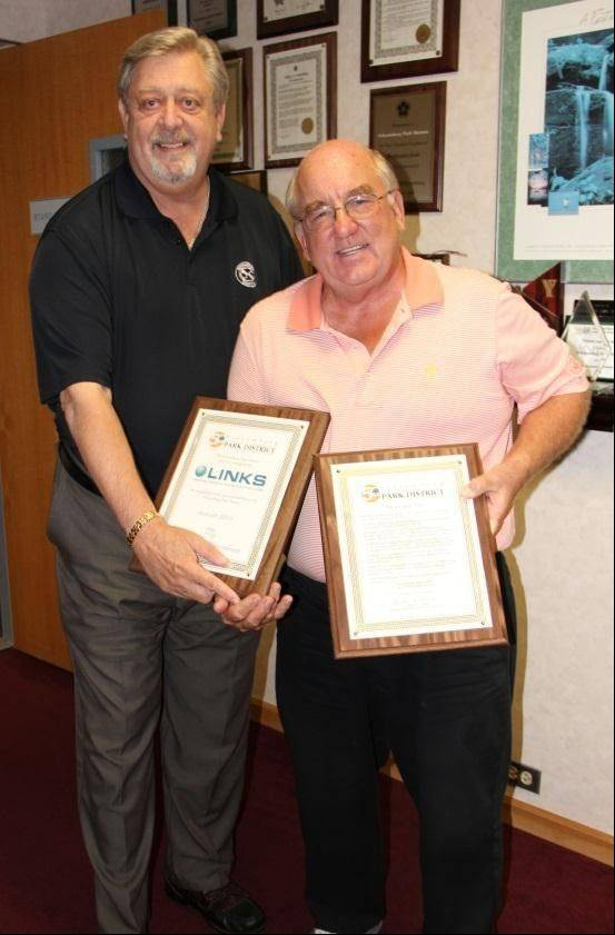 Park board President Mike Daniels, left, presents a plaque to Links Technology founder, president and CEO Brian Burke.