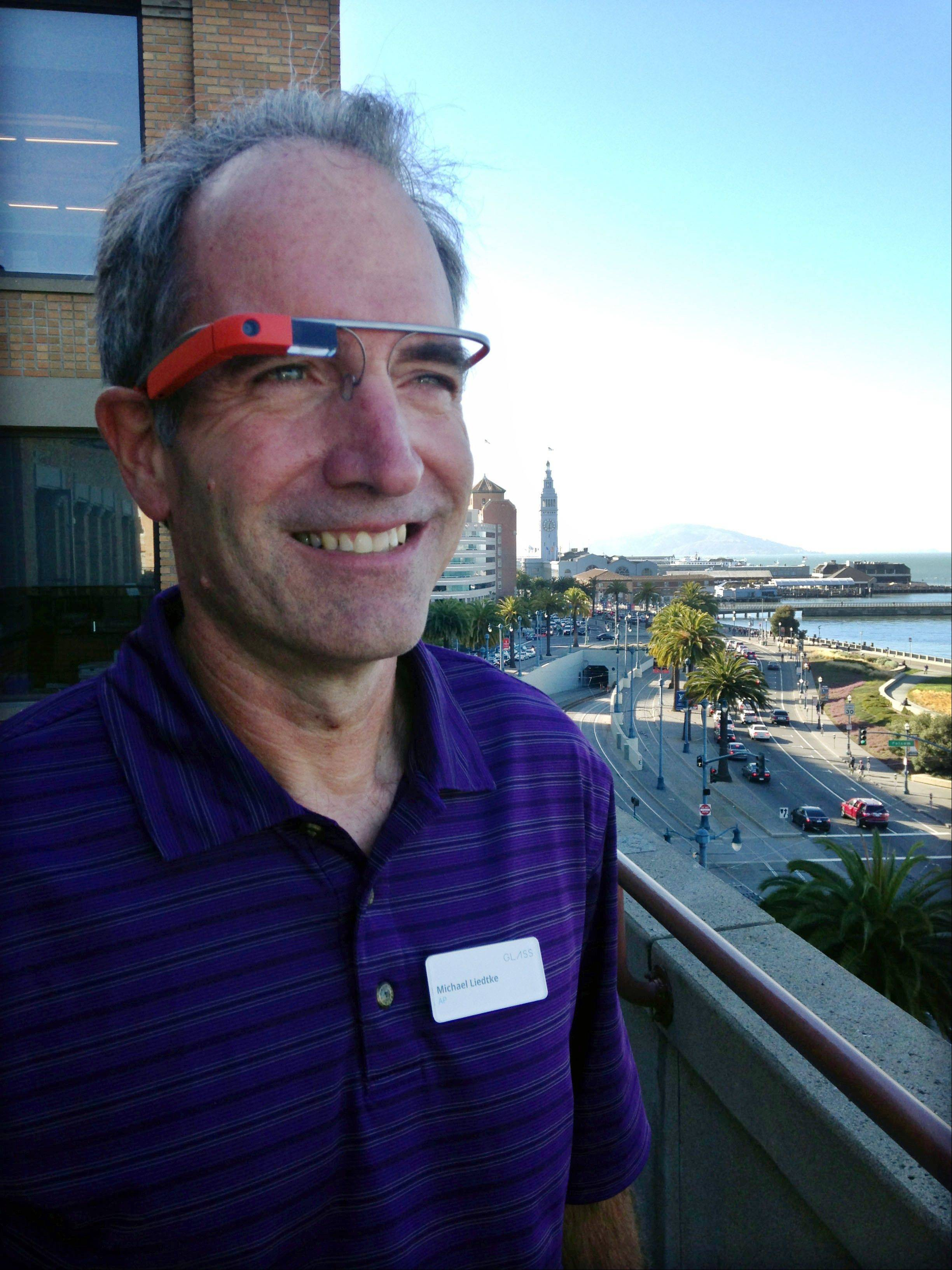 Associated Press reporter Michael Liedtke models Google Glass at a Google base camp in San Francisco. Google Inc. is touting Glass as a liberating breakthrough that will make technology more convenient and less obnoxious in social situations than checking a smartphone to see what's happening in your digital realm.