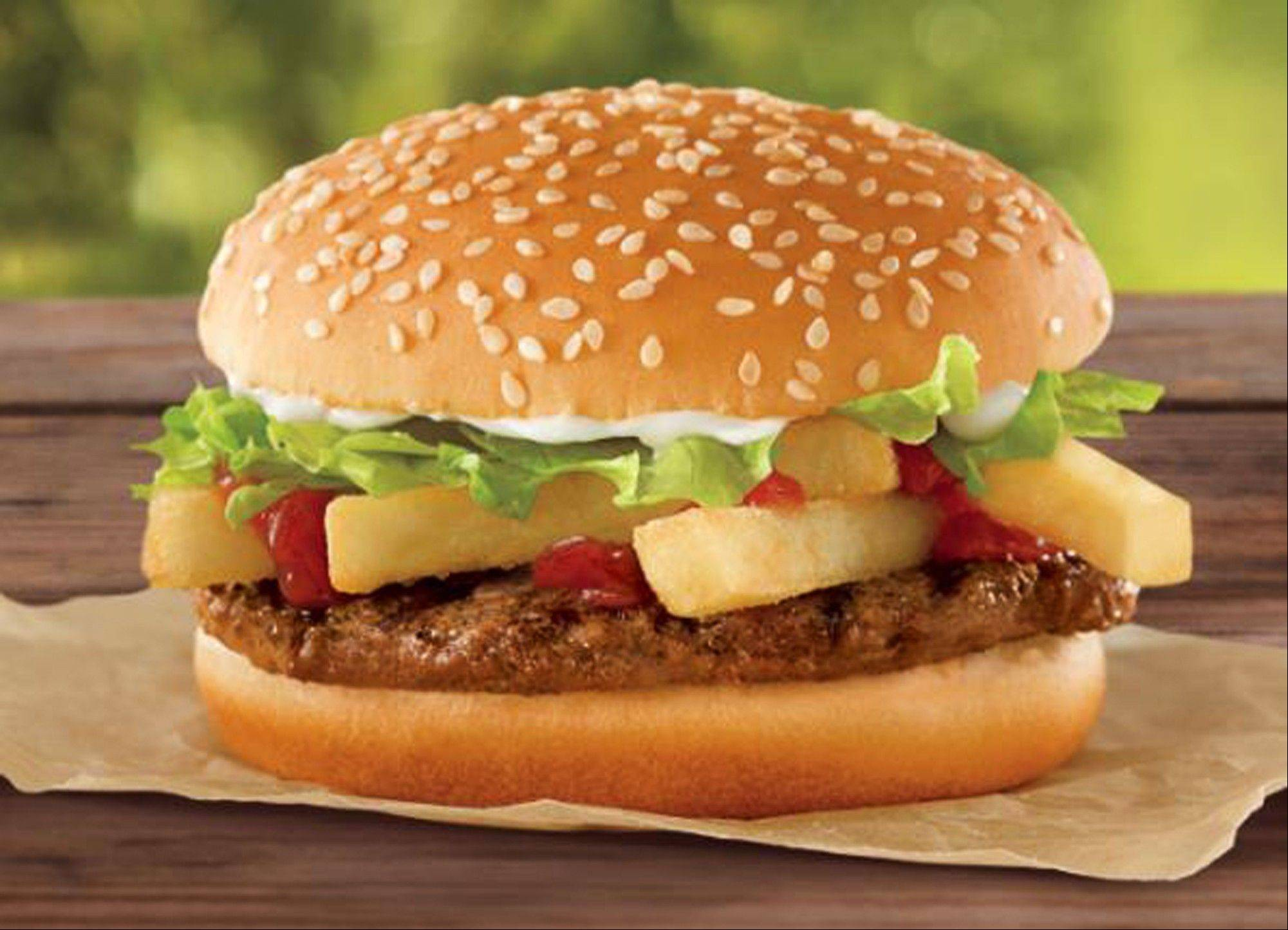 This undated photo provided by Burger King shows a a �French Fry Burger,� which Burger King is rolling out for $1 as the company looks to fend off a Dollar Menu push by McDonald�s.