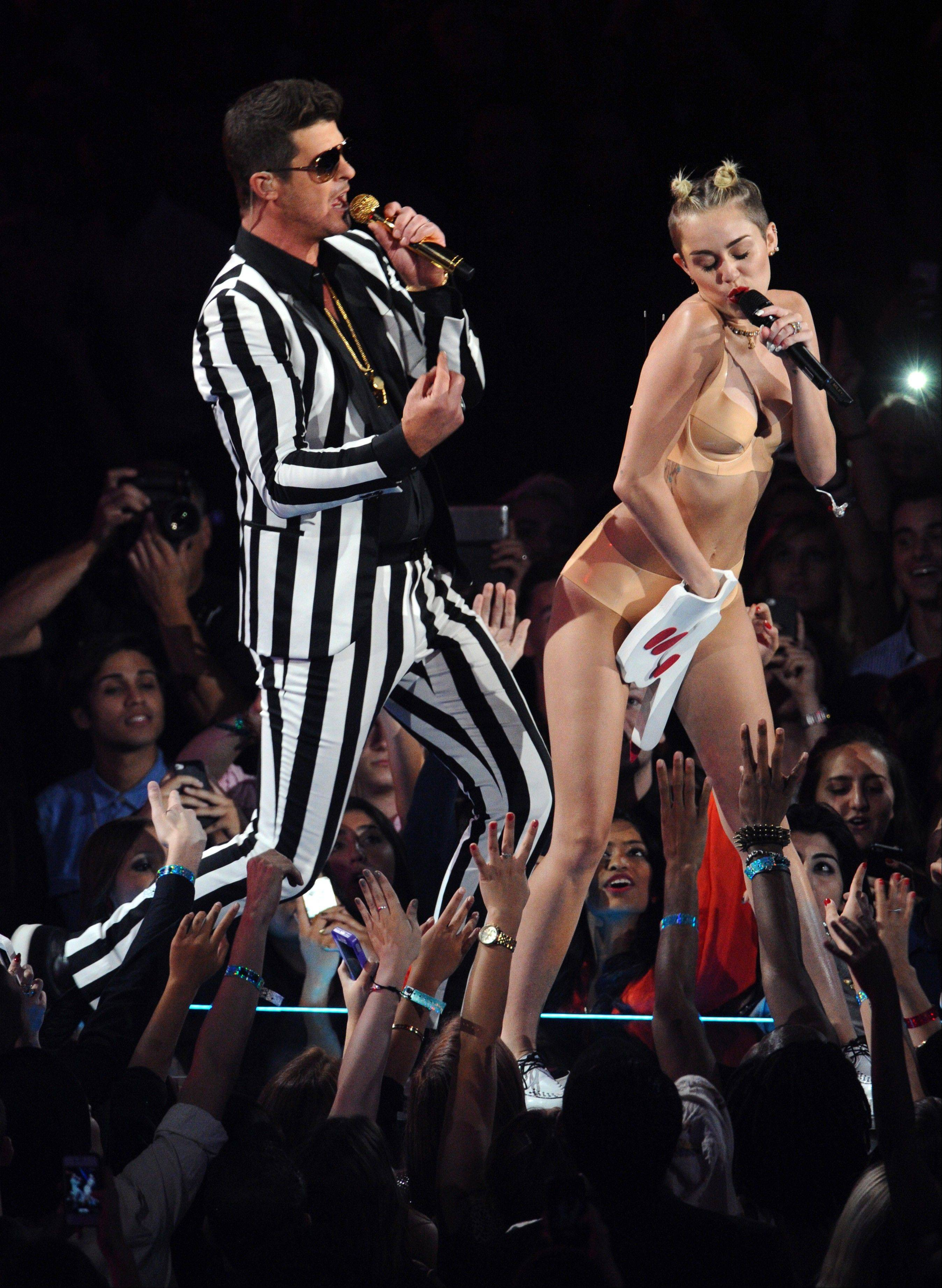 "Robin Thicke and Miley Cyrus perform ""Blurred Lines"" at the MTV Video Music Awards on Sunday."