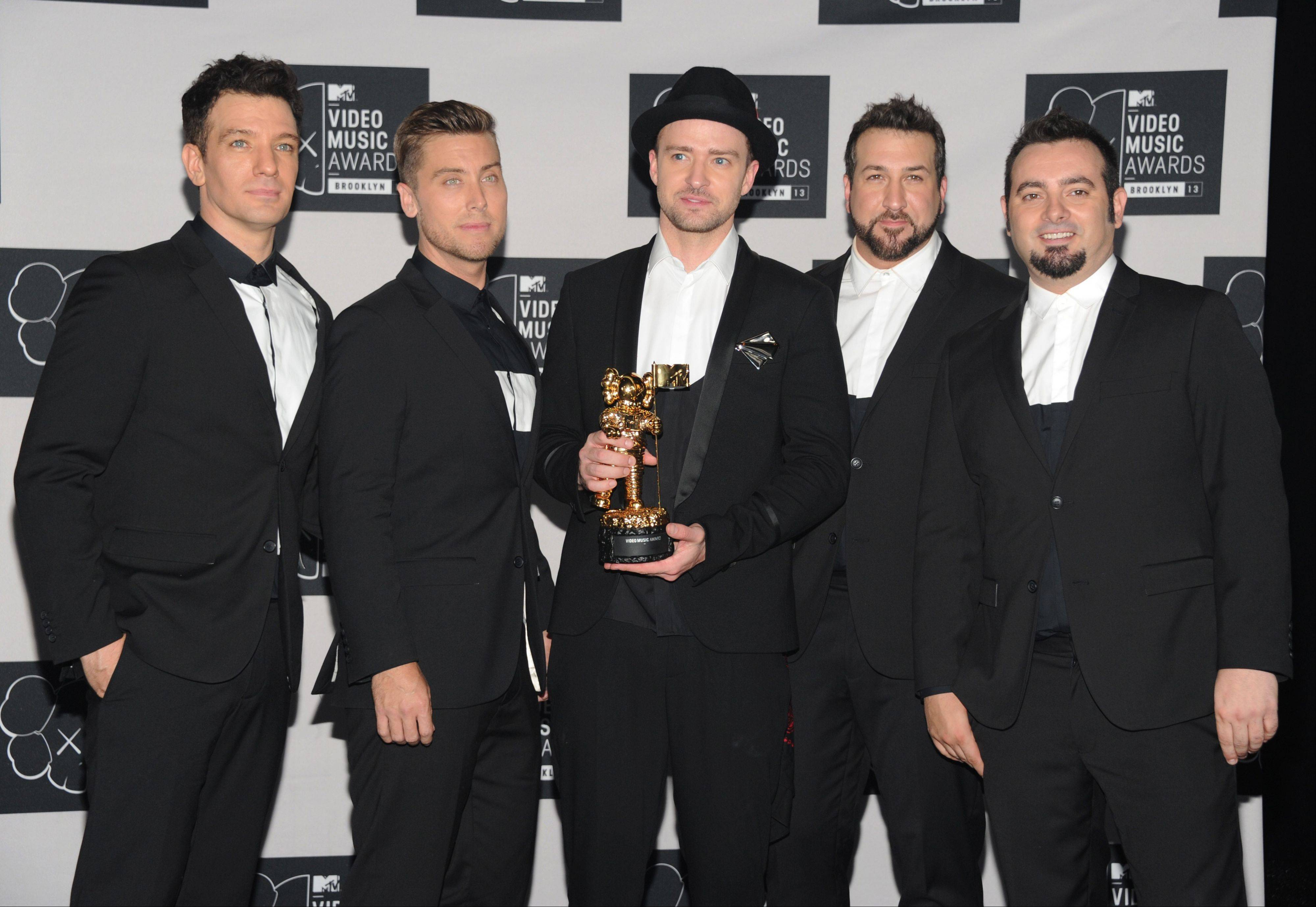 Justin Timberlake, center, winner of the video vanguard award with, from left, JC Chasez, Lance Bass, Joey Fatone and Chris Kirkpatrick of 'N Sync at the MTV Video Music Awards on Sunday.