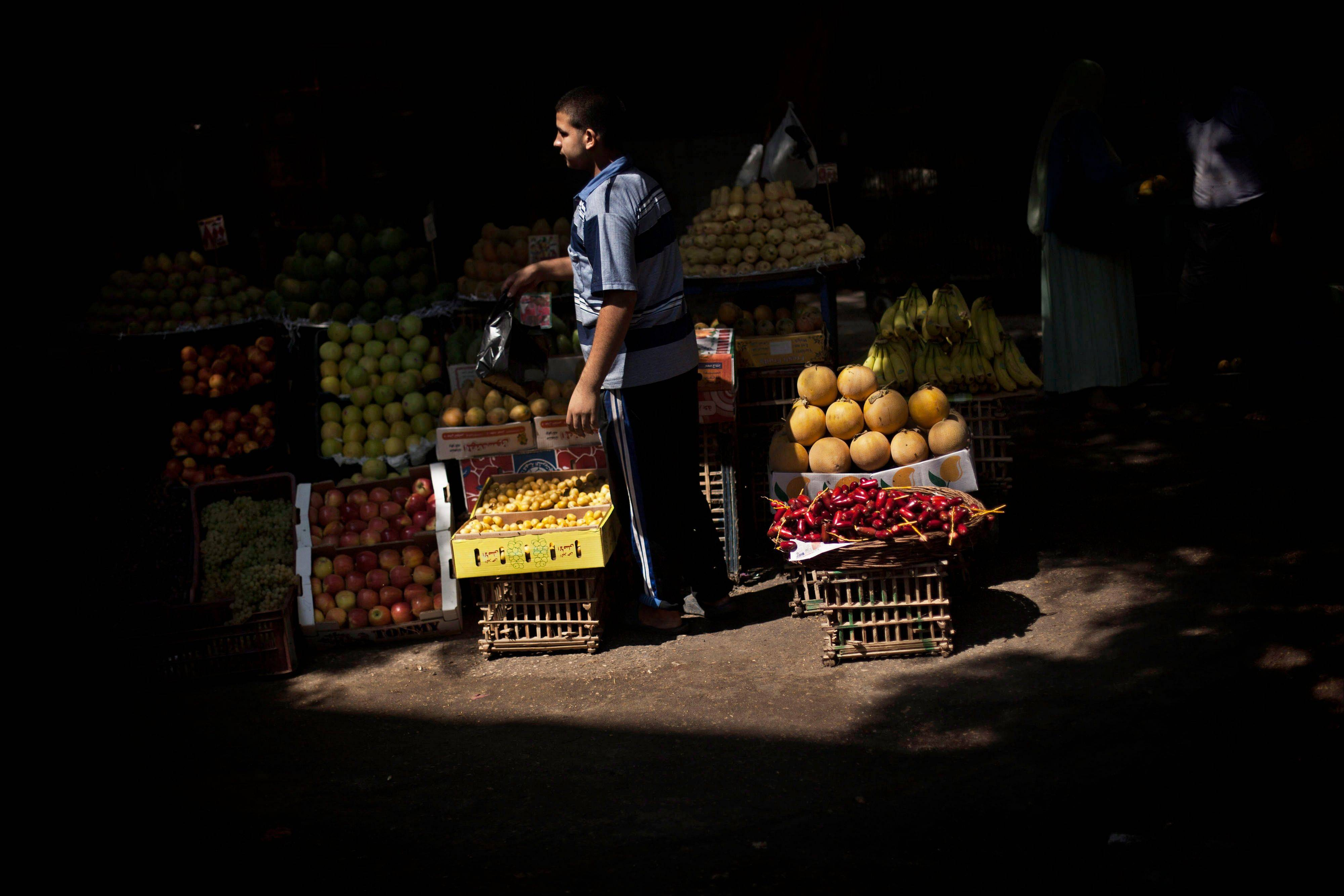 A fruit vendor waits for customers at Suleiman Gohar market in Dokki district in Cairo, Egypt. Egypt's recent turmoil has scared away tourists and†affected the livelihood of the†one in eight Egyptians who earn their living from tourism.