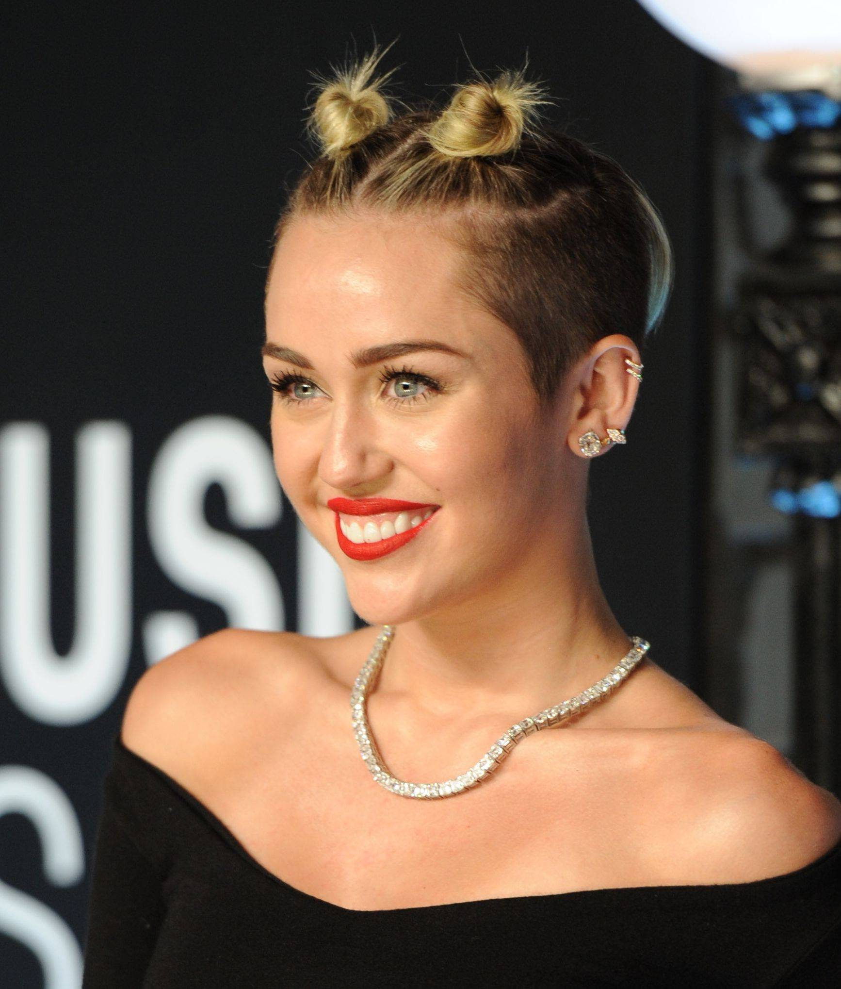 Miley Cyrus arrives at the MTV Video Music Awards on Sunday — before she did her best to promote the Oxford dictionary's newest word.