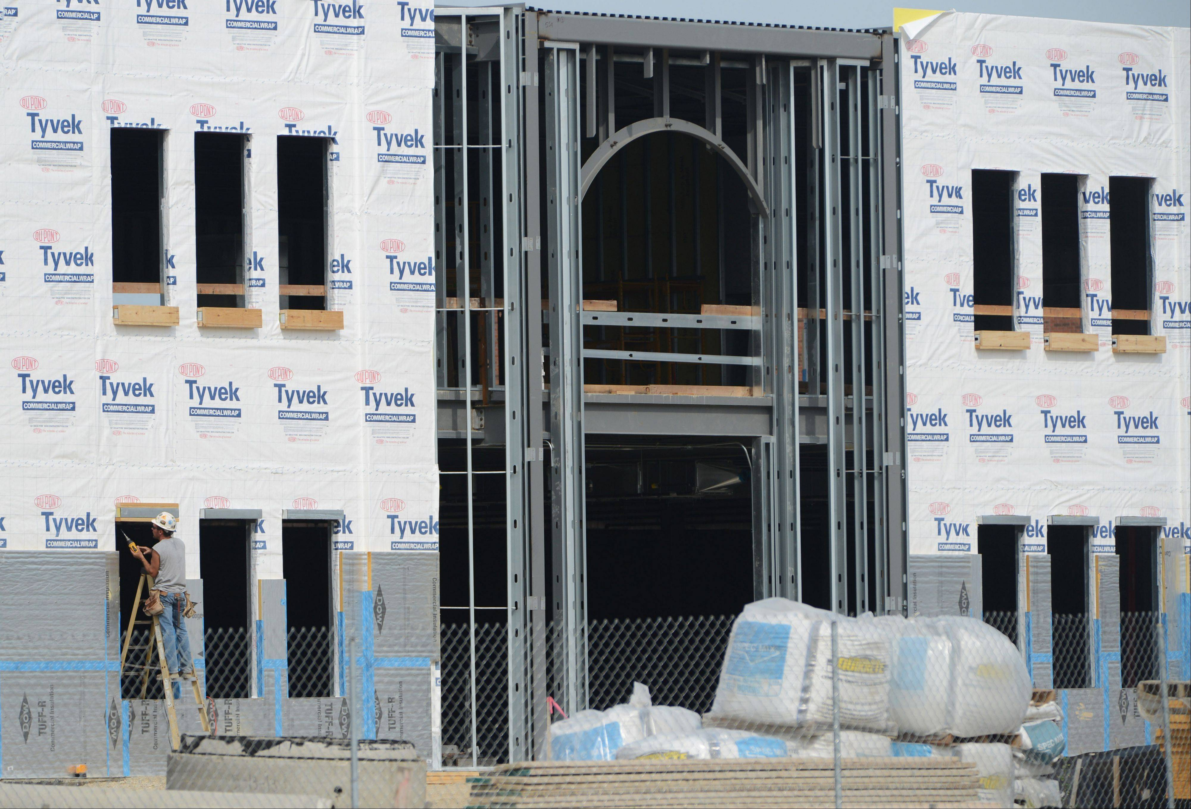 As Mundelein's new village hall is built, officials are preparing for the future by installing underground conduit that could be used to charge electric cars.
