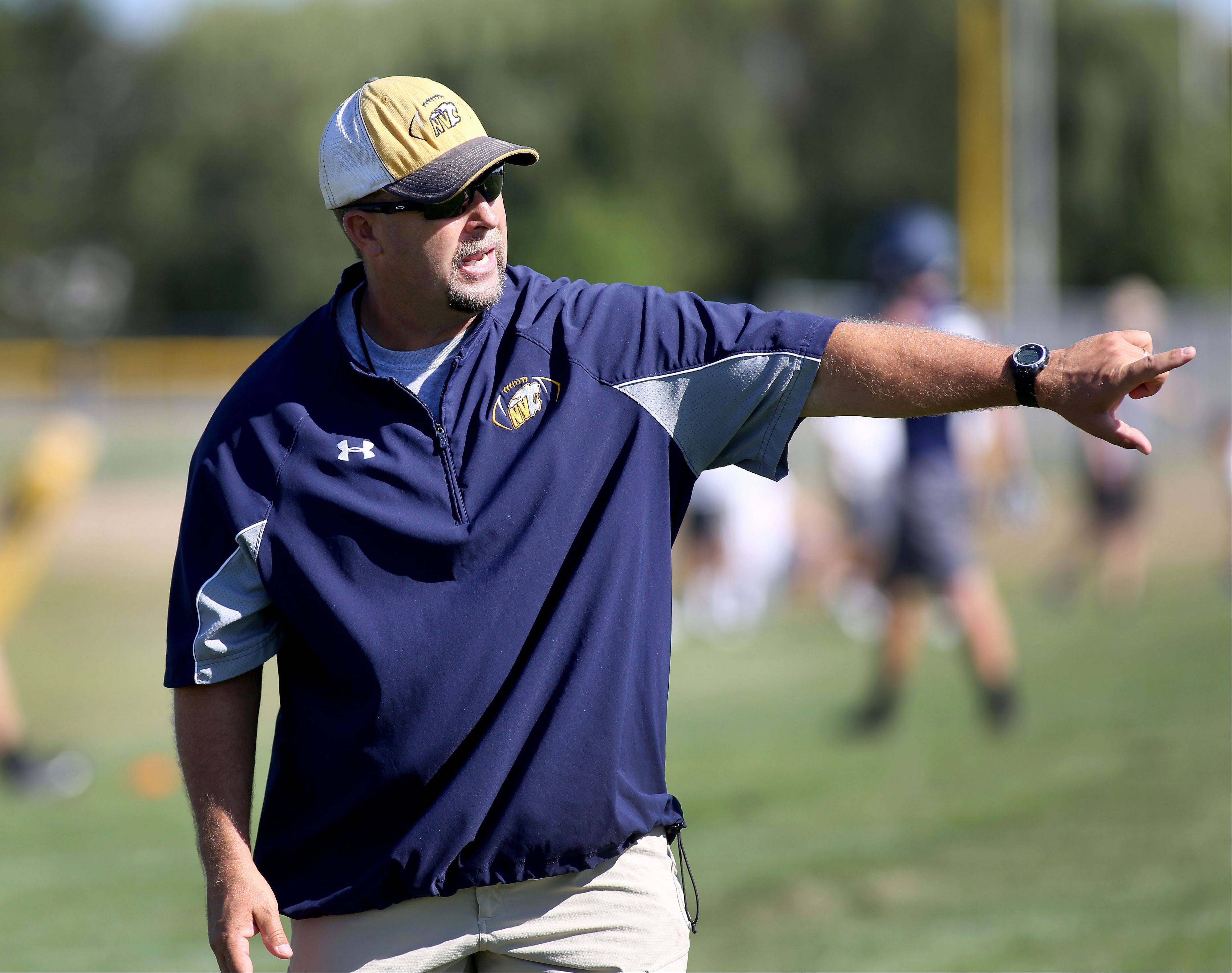 Neuqua Valley football coach Bill Ellinghaus leads practice on Wednesday in Naperville.