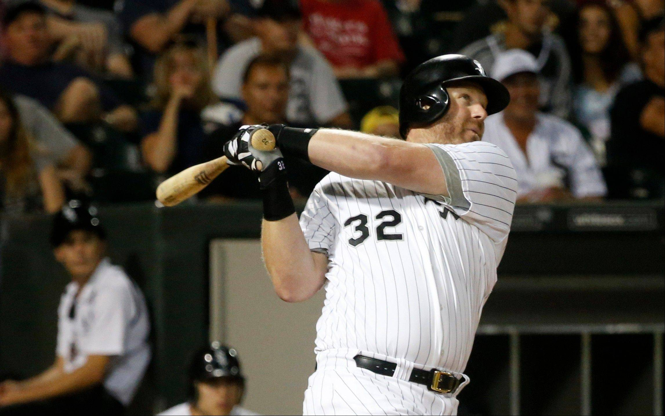 The White Sox's Adam Dunn watches his two-run home run off Houston Astros starting pitcher Brett Oberholtzer, also scoring Paul Konerko, during the sixth inning of the game Monday in Chicago.