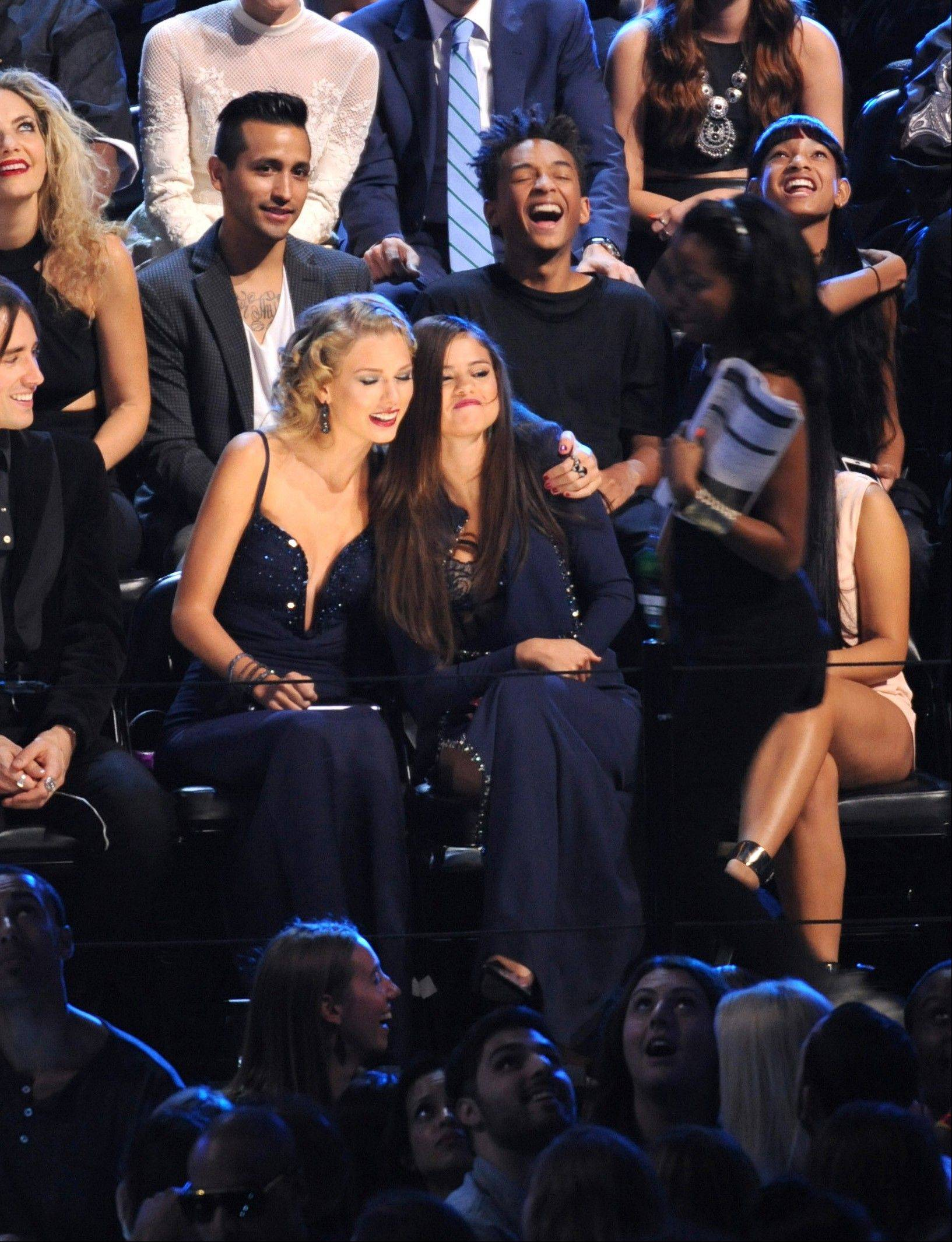 Taylor Swift, center left, and Selena Gomez sat together at the MTV Video Music Awards on Sunday.