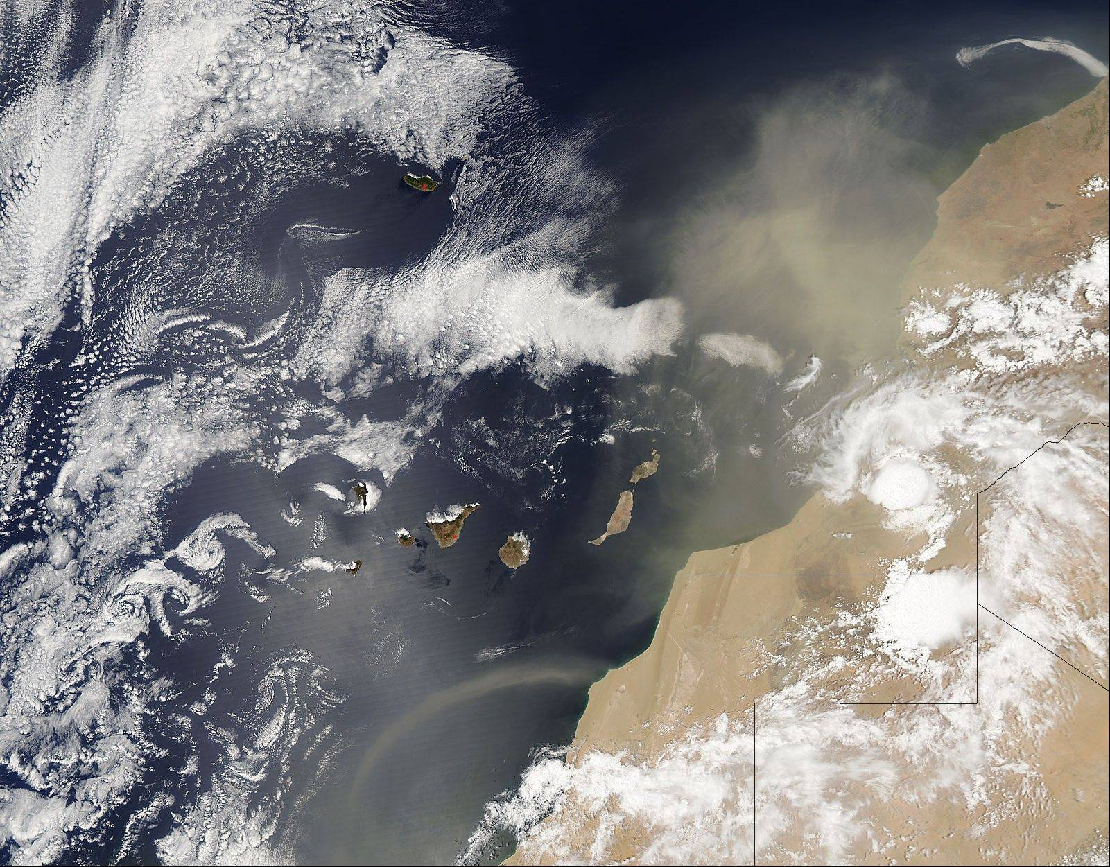 In this Aug. 19 satellite image provided by the NASA, African dust blowing over the eastern Atlantic Ocean is seen approaching the Canary Islands.