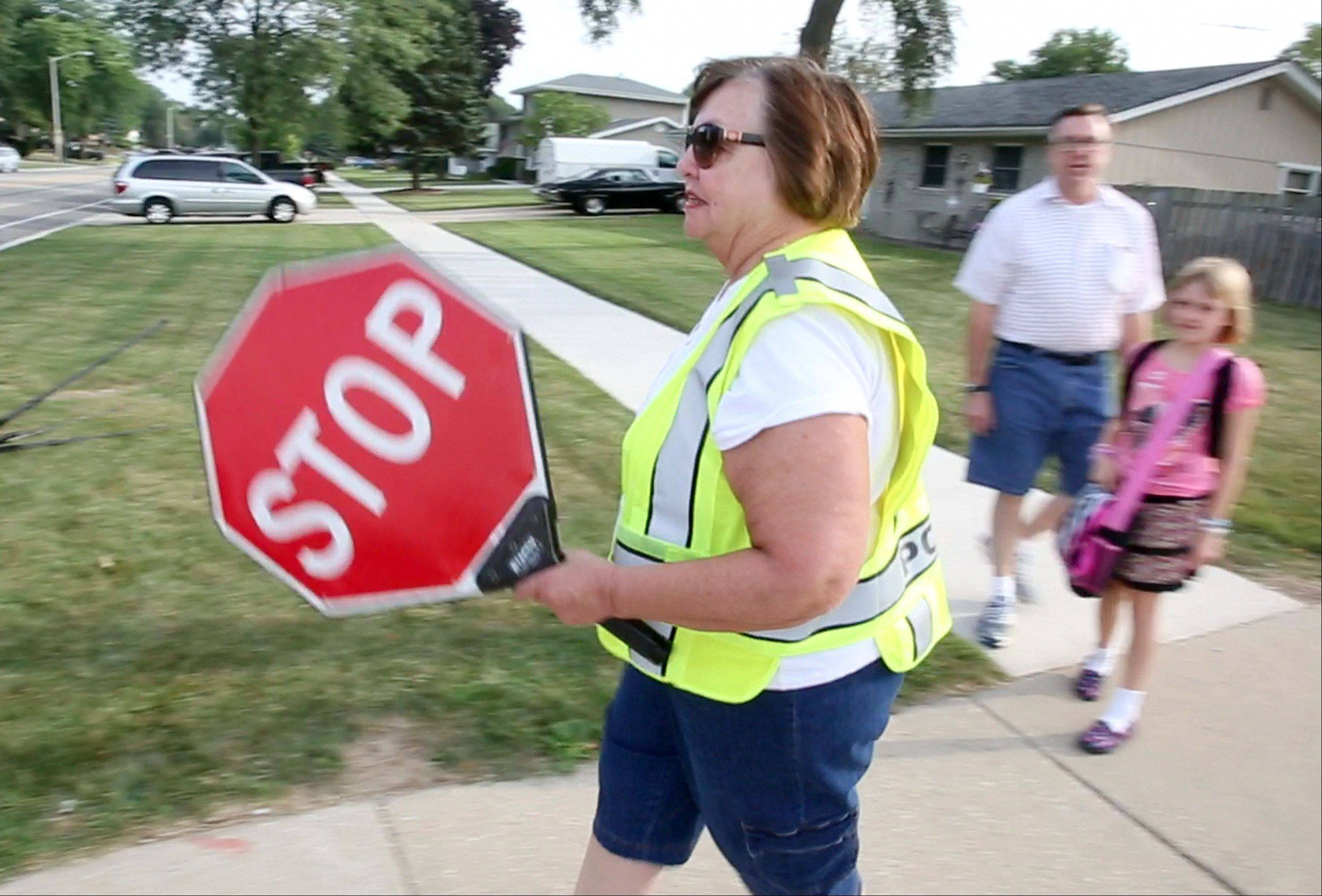 Sue Denys of Schaumburg was among the crossing guards honored Tuesday as Schaumburg police marked Crossing Guard Appreciation Day. Denys helps children only across the intersection of Braintree Drive and Wise Road on their way to Nathan Hale Elementary School.