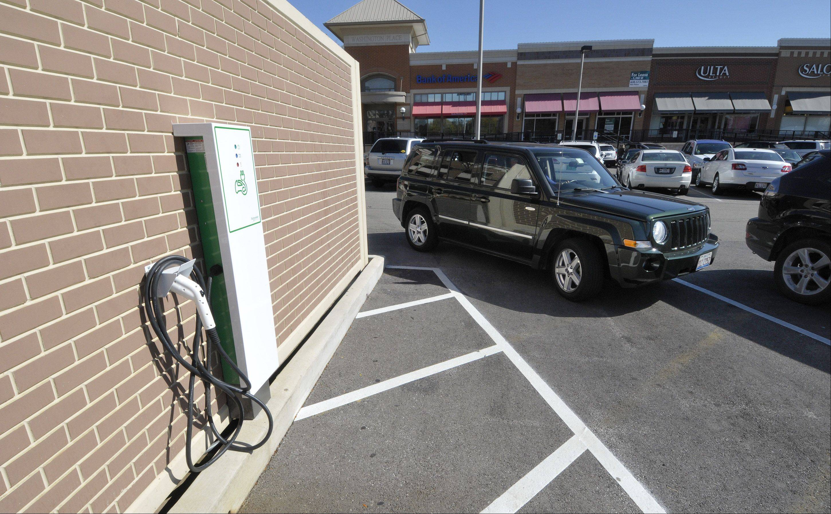 Downtown Naperville has charging stations for electric and hybrid cars. Mundelein officials are adding conduits at the site of a new village hall for similar equipment.